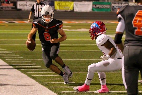 Burkburnett quarterback Mason Duke steps out of bounds for a gain during the first quarter Friday night in Burkburnett.