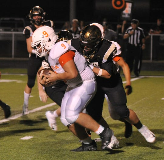 Petrolia Pirates, Tight End, Aj Rivera works to break being tackled, Friday night during their game against the Archer City Wildcats in Archer City.