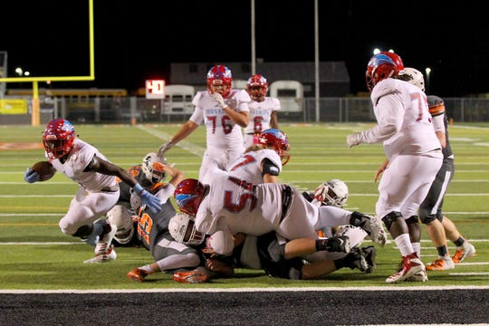 Hirschi's Daimarqua Foster twists out of the pack for a touchdown Friday night in Burkburnett.