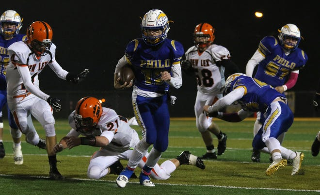 Philo's Aaron Philip heads to the end zone against New Lexington.
