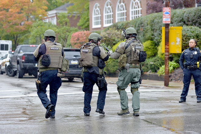 Police respond to an active shooter situation at the Tree of Life synagogue in the Squirrel Hill neighborhood of Pittsburgh, Pa., on Saturday, October 27, 2018.
