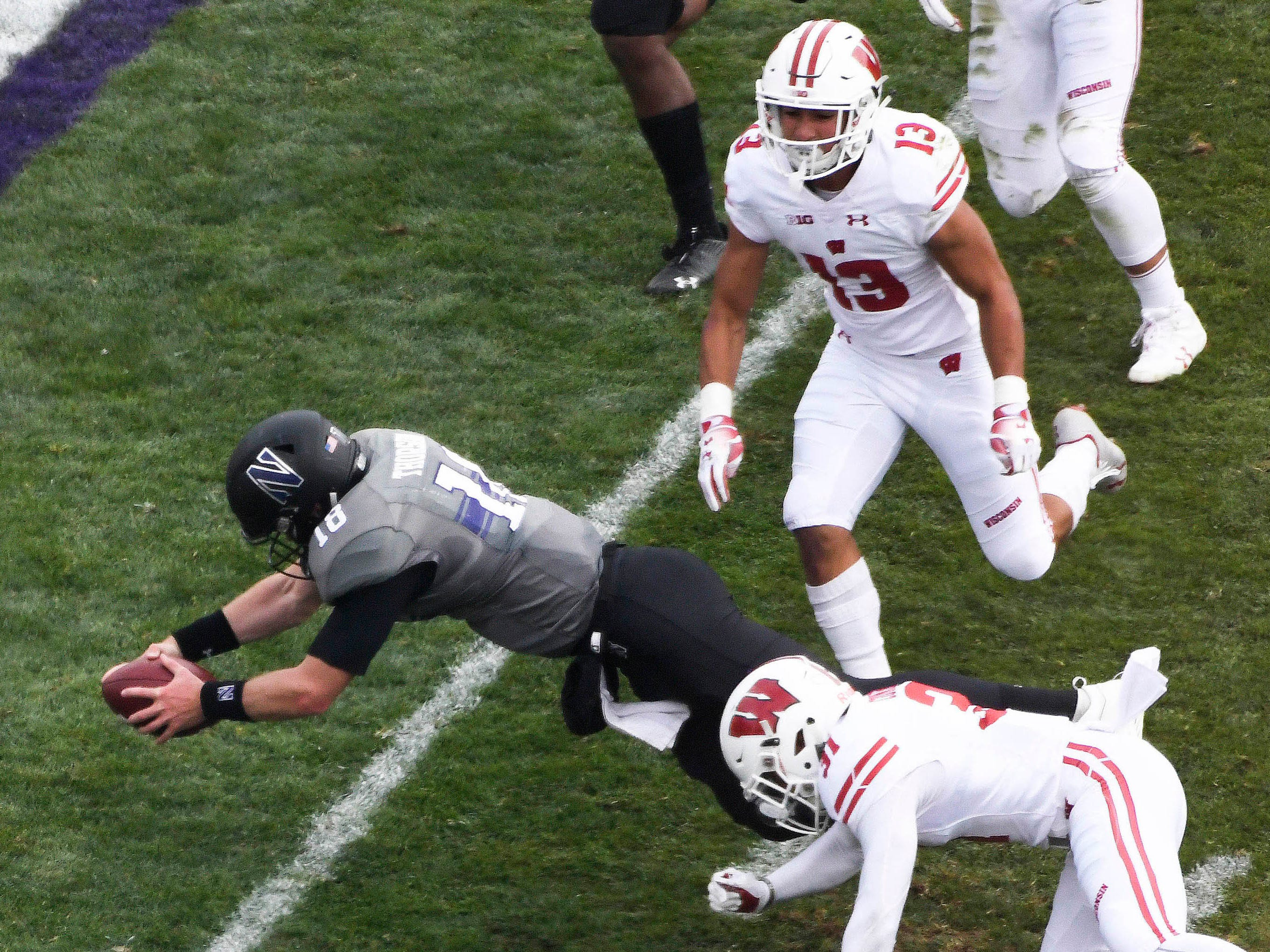 Northwestern Wildcats quarterback Clayton Thorson (18) scores a touchdown against the Wisconsin Badgers at Ryan Field.