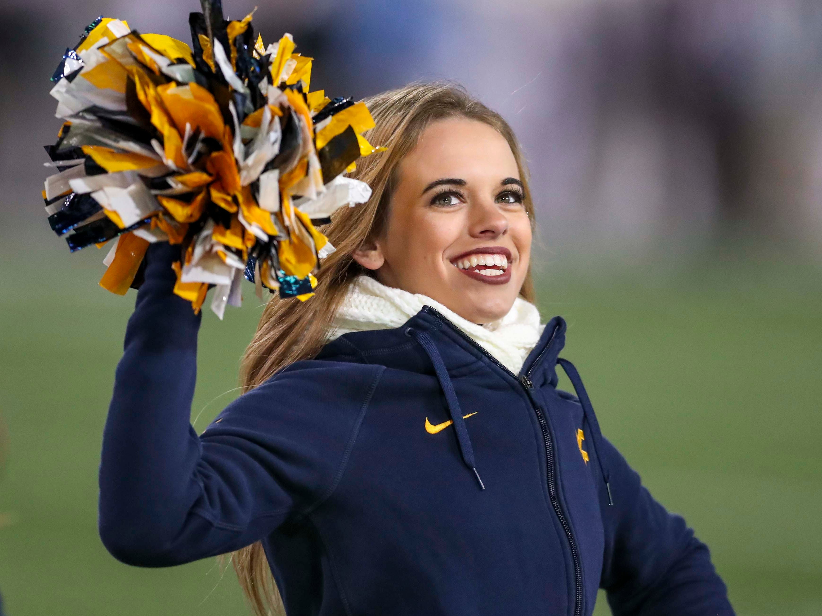 Week 9: A West Virginia Mountaineers cheerleader performs during the third quarter against the Baylor Bears at Mountaineer Field at Milan Puskar Stadium.