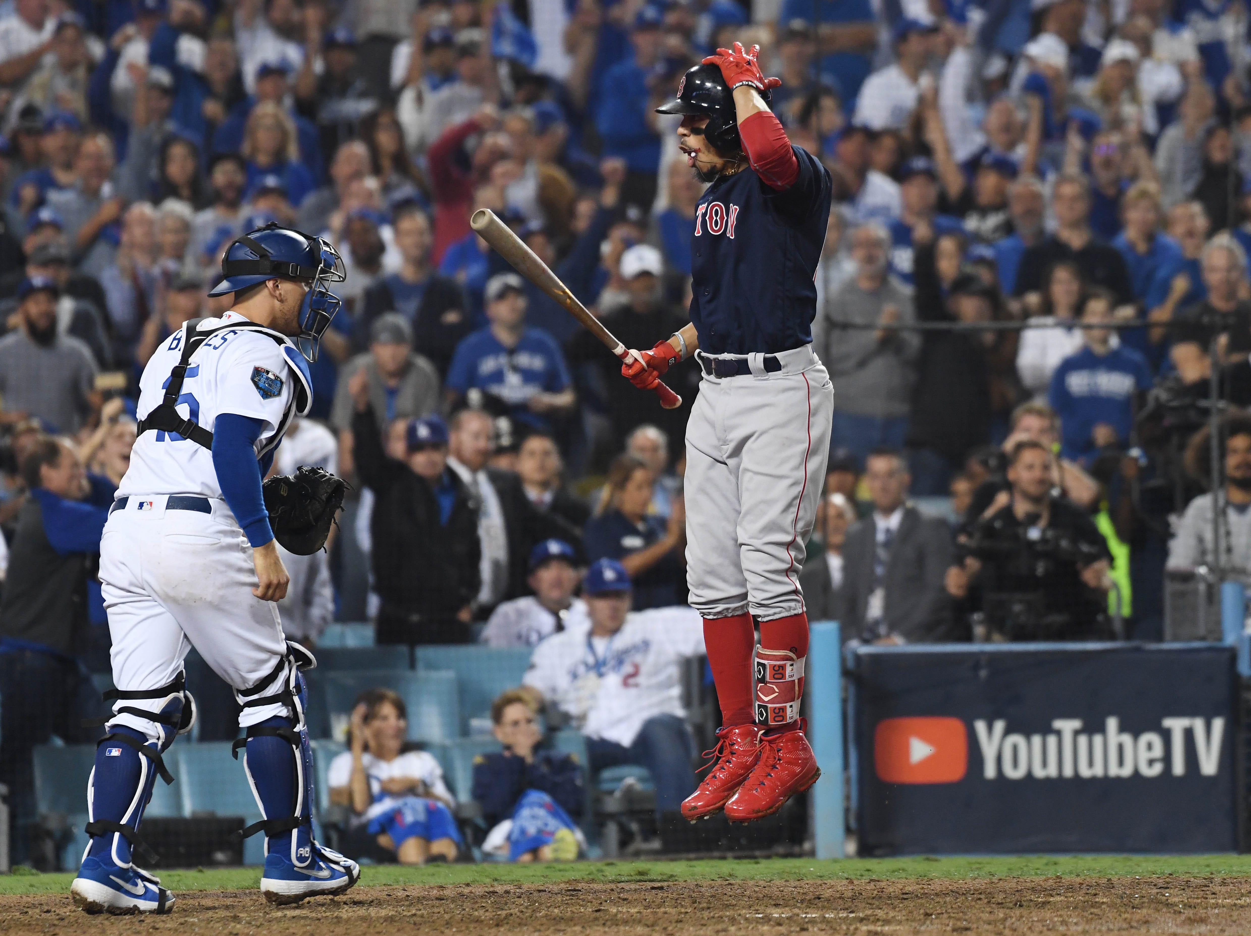 Game 3 at Dodger Stadium: Mookie Betts reacts to a called third strike in the 15th inning.