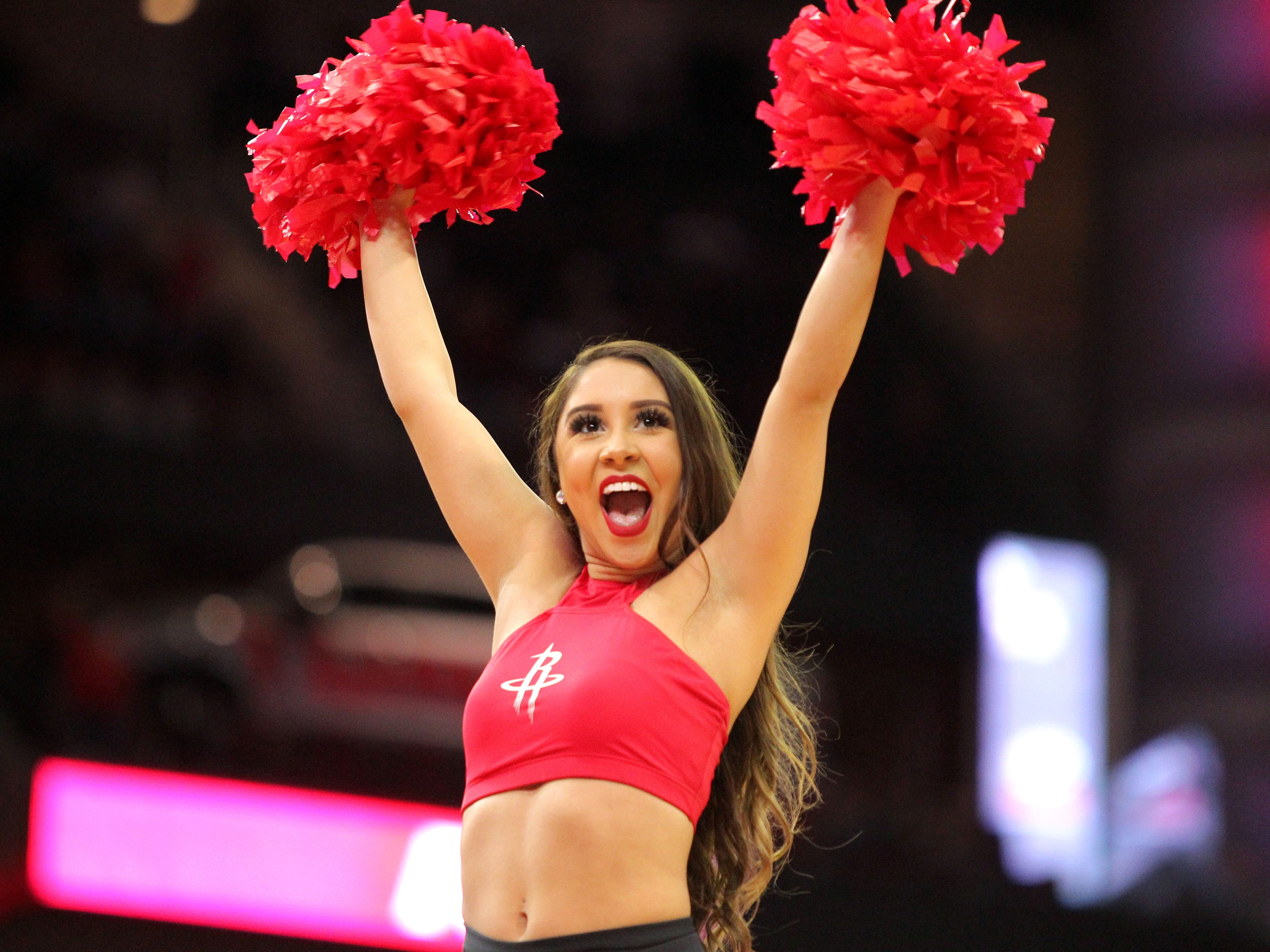 Oct. 26: A Rockets cheerleader fires up the crowd during a game against the Clippers.