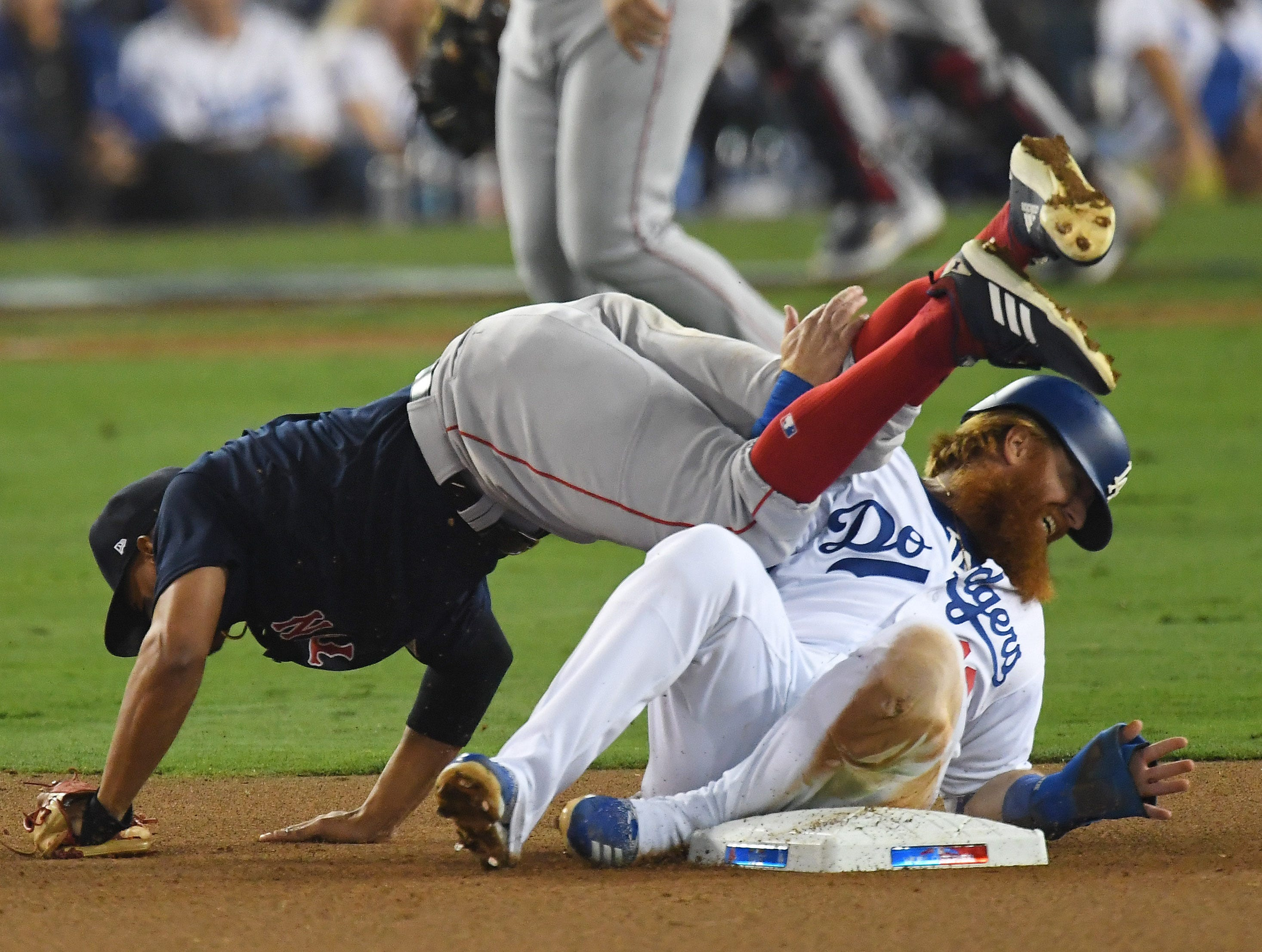 Game 3 at Dodger Stadium: Justin Turner slides into Xander Bogaerts in the eighth inning.