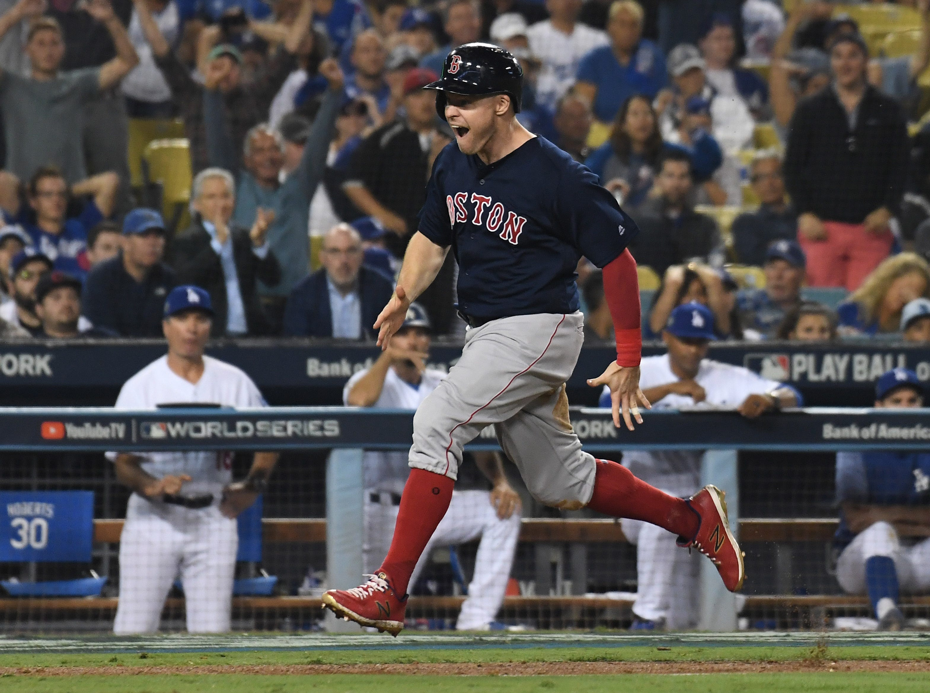 Game 3 at Dodger Stadium: Brock Holt scores in the 13th inning.
