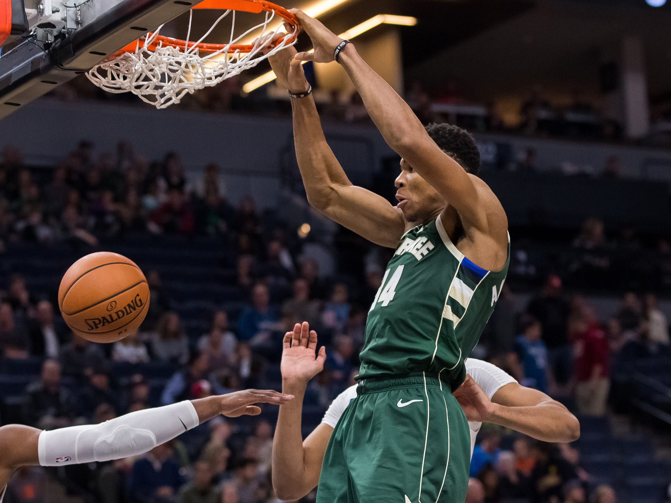Oct. 26: Bucks forward Giannis Antetokounmpo throws down a monster two-handed slam during the second half against the Timberwolves in Minneapolis.