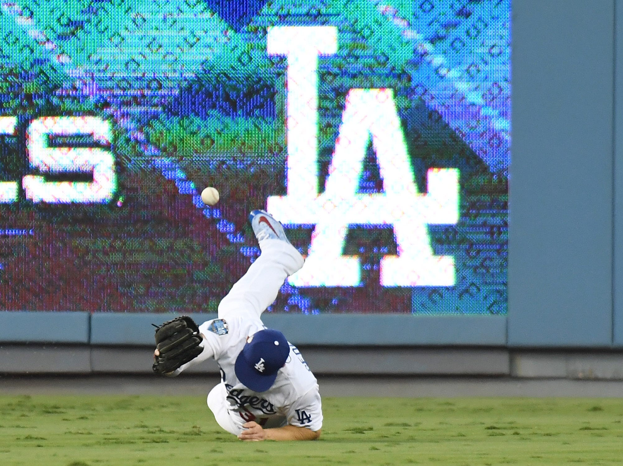 Game 3 at Dodgers Stadium: Left fielder Joc Pederson can't catch a single hit by Christian Vazquez in the third inning.
