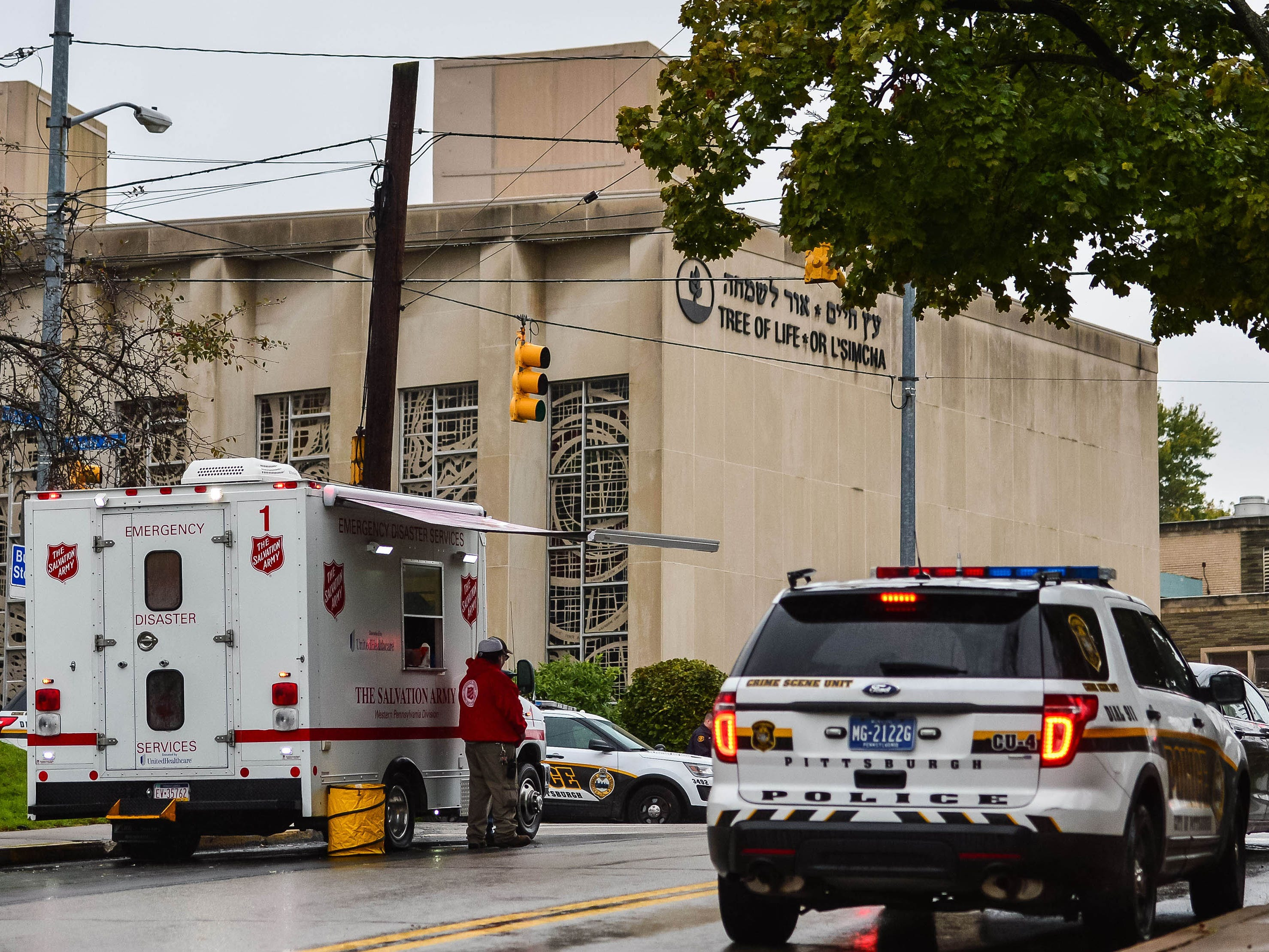 Police outside and a disaster response team outside the Tree of Life Congregation in the Squirrel Hill neighborhood of Pittsburgh.