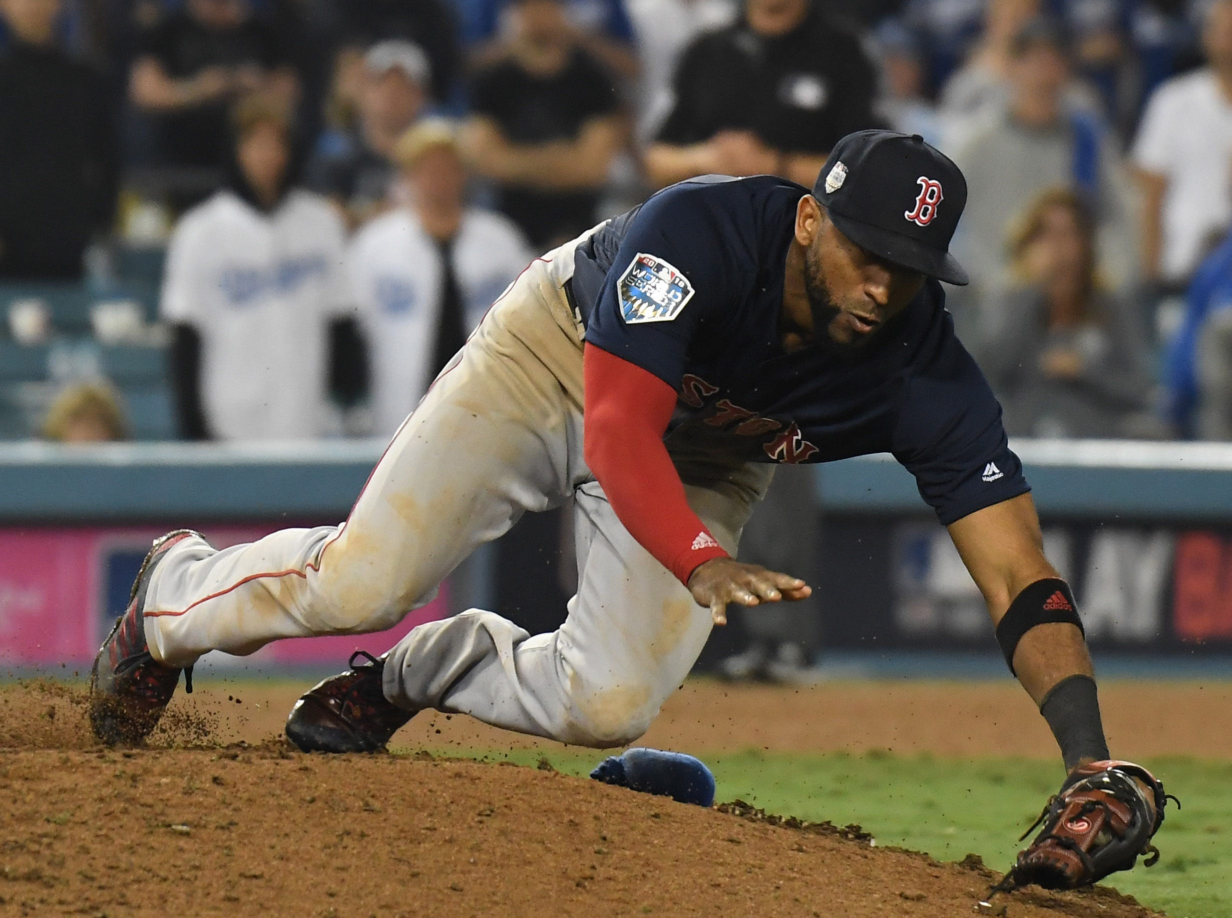 Game 3 at Dodger Stadium: Eduardo Nunez falls over the mound while making a catch on a pop up in the 16th inning.