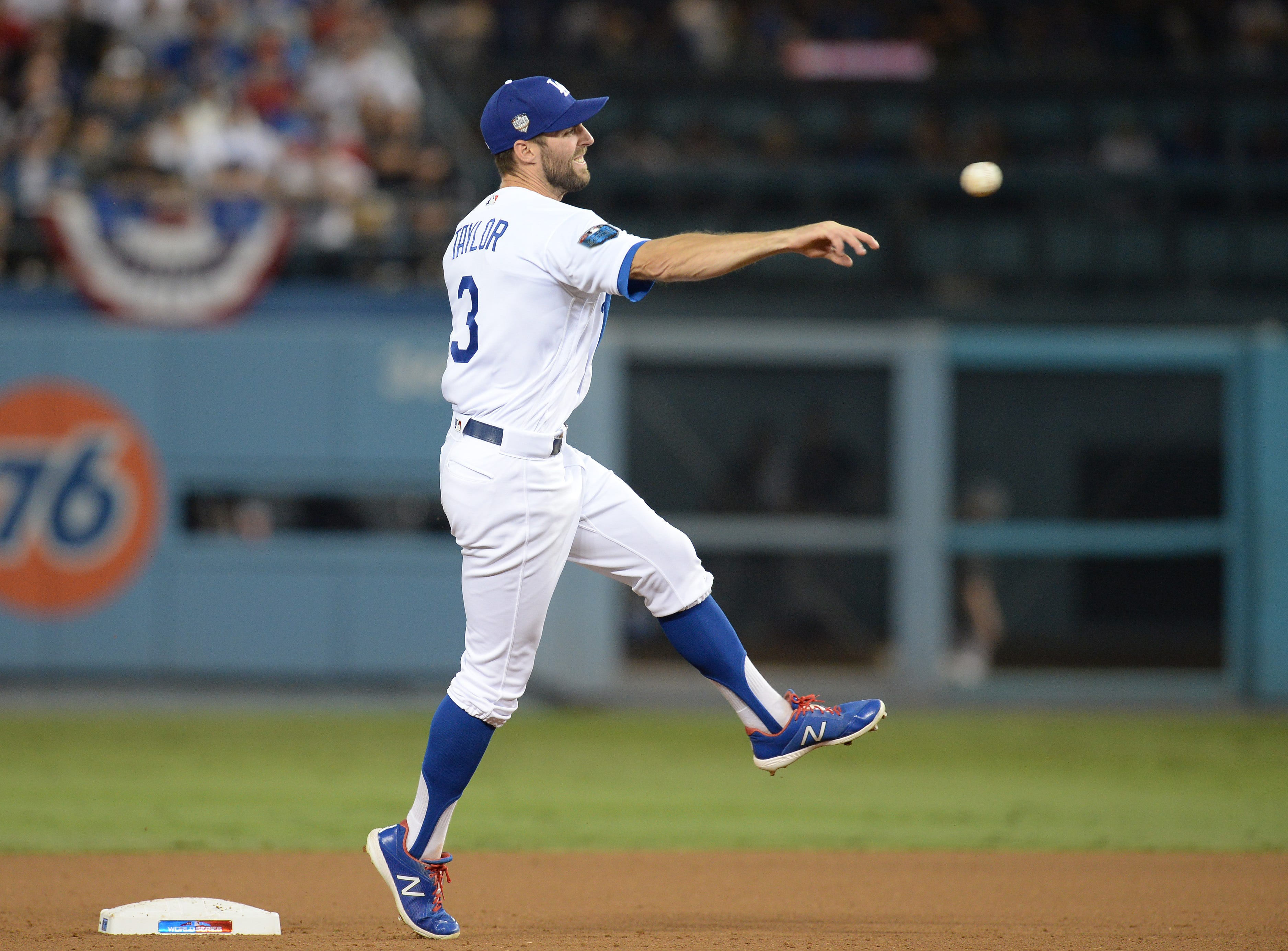 Game 3 at Dodger Stadium: Second baseman Chris Taylor makes a throw to first in the sixth inning.