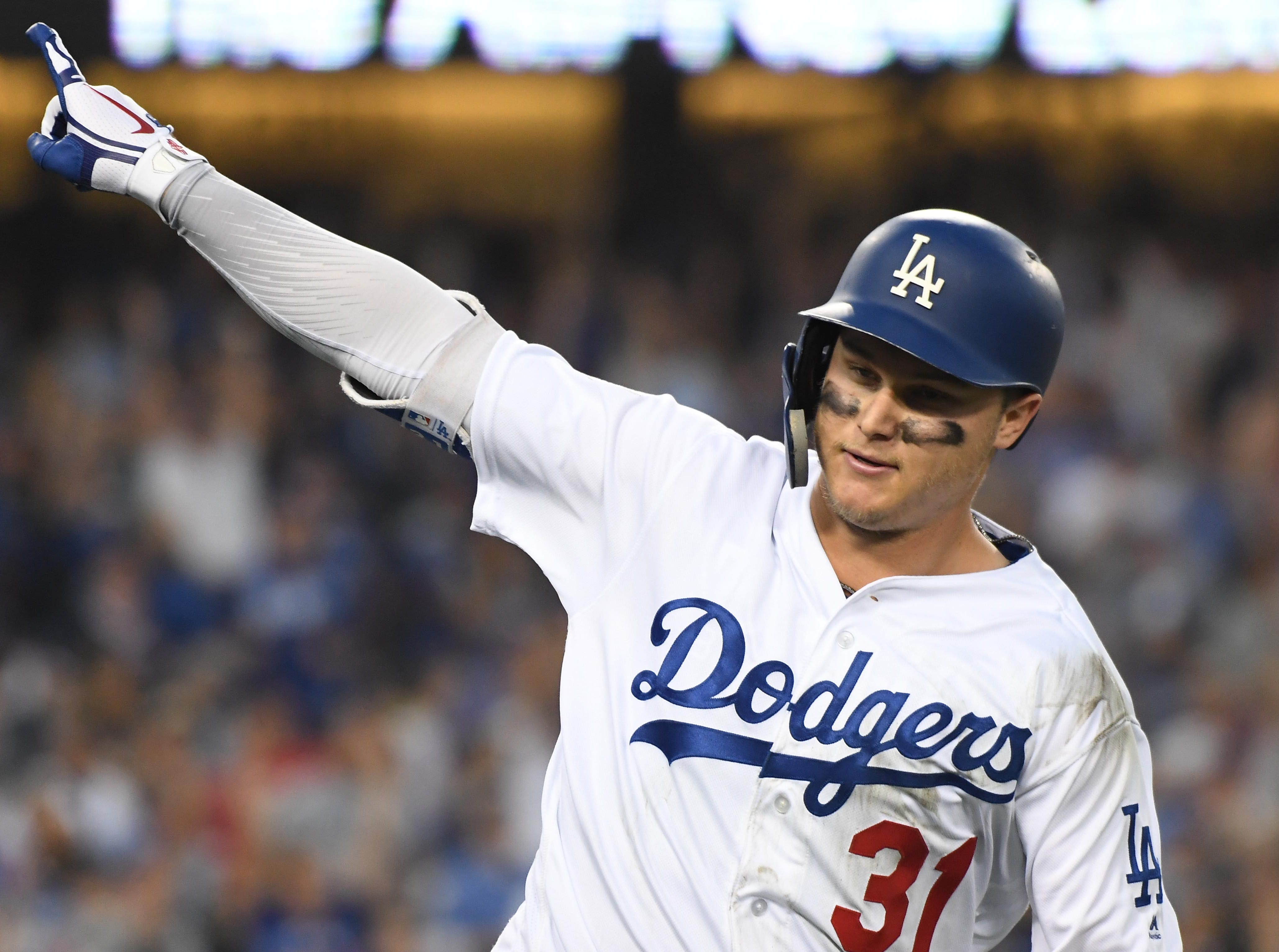 Game 3 at Dodger Stadium: Joc Pederson celebrates after hitting a solo homer in the thirdOct 26, 2018; Los Angeles, CA, USA; Los Angeles Dodgers outfielder Joc Pederson (31) celebrates after hitting a solo home run against the Boston Red Sox in the third inning in game three of the 2018 World Series at Dodger Stadium. Mandatory Credit: Richard Mackson-USA TODAY Sports.