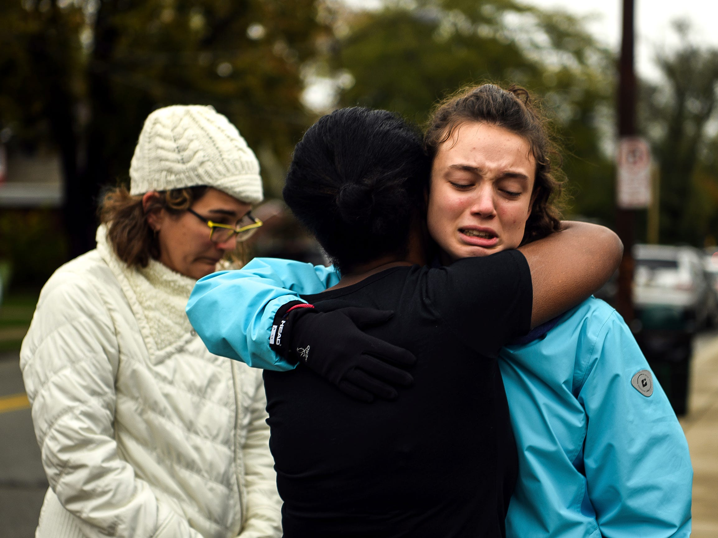 Tammy Hepps, hugs Simone Rothstein, right, on the intersection of Shady Avenue and Northumberland Street after multiple people were shot at The Tree of Life Congregation synagogue.