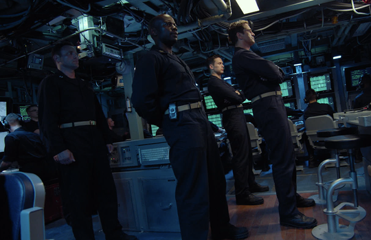 "Gerard Butler, right, is Captain Joe Glass, who takes his nuclear submarine on a fast ascent in ""Hunter Killer."""