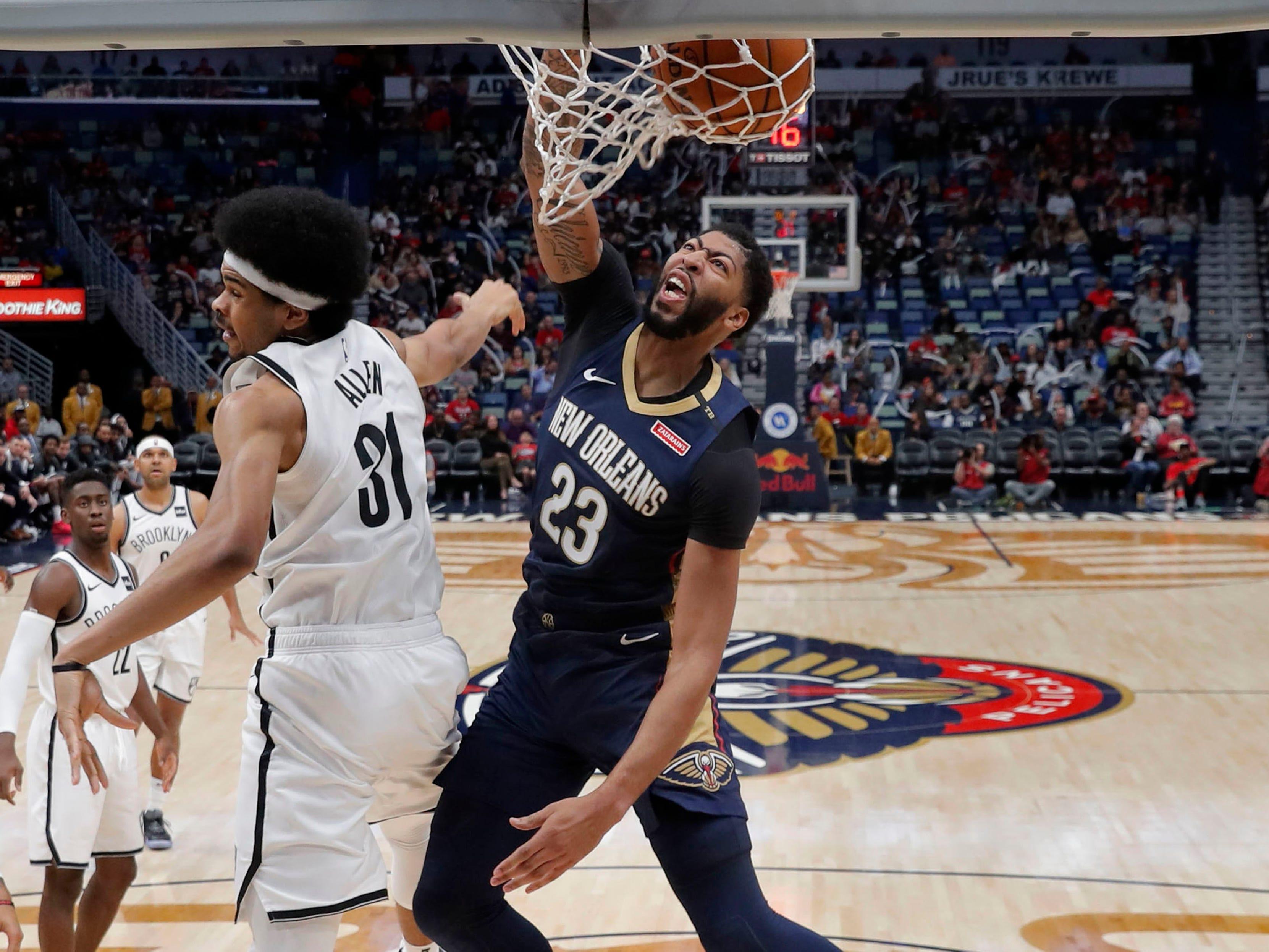 Oct. 26: Pelicans forward Anthony Davis (23) puts down a monster one-handed flush over Nets defender Jarrett Allen (31).
