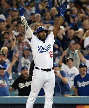 Dodgers outfielder Yasiel Puig celebrates after hitting an RBI single in the 13th inning.