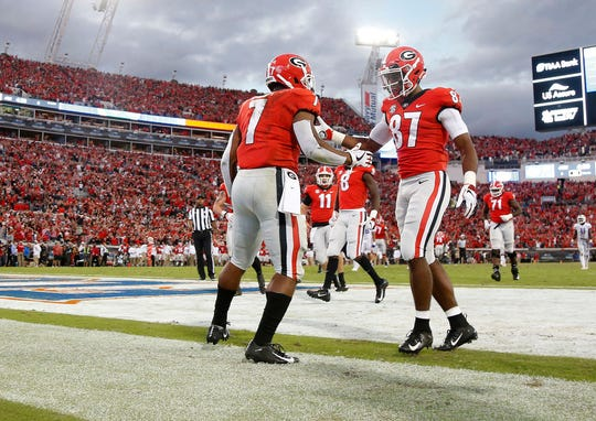 Georgia running back D'Andre Swift (7) is congratulated by wide receiver Tyler Simmons after scoring a touchdown against Florida.