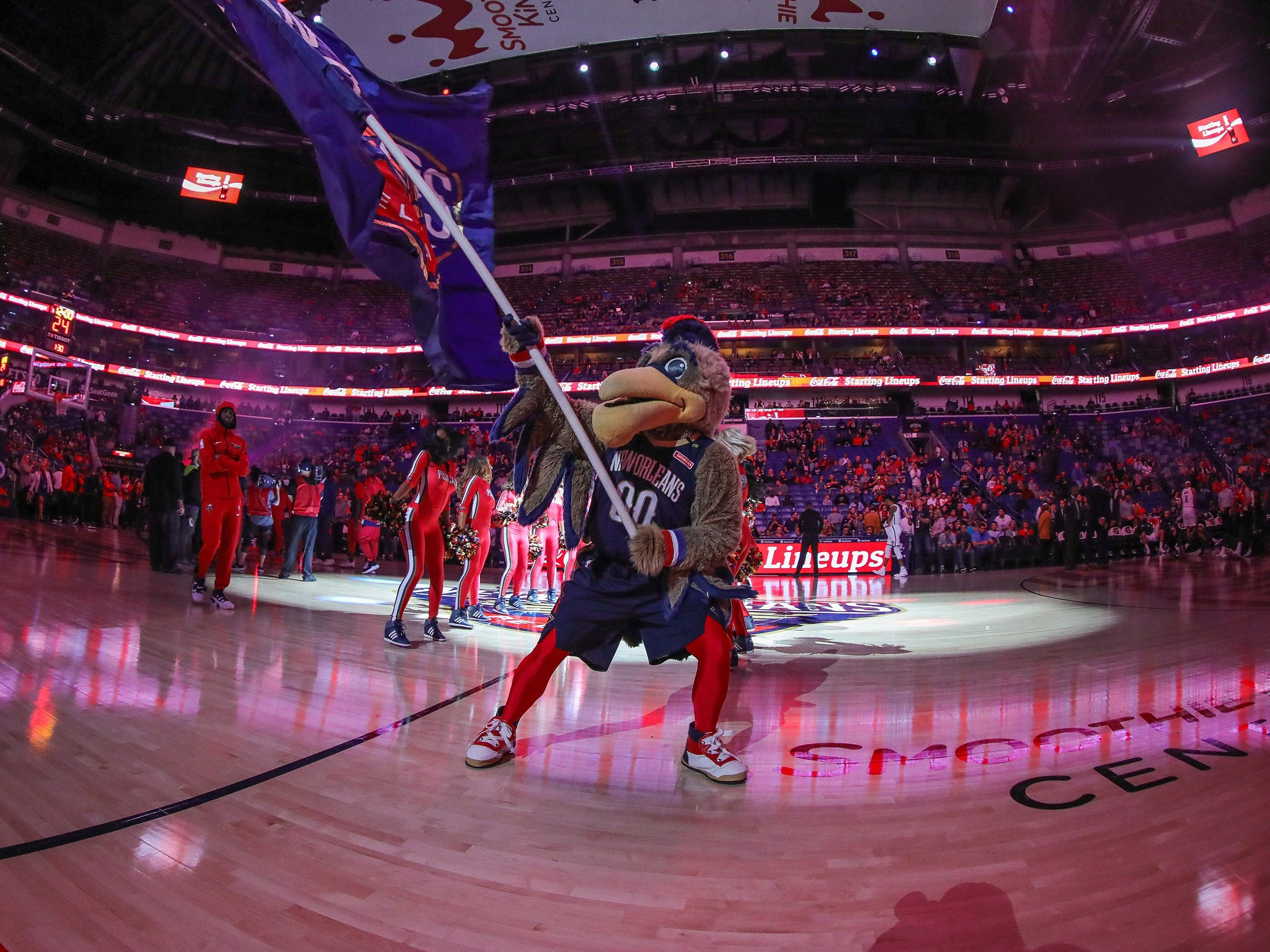 Oct. 26: Pelicans mascot Pierre pumps up the fans before playing the Nets.