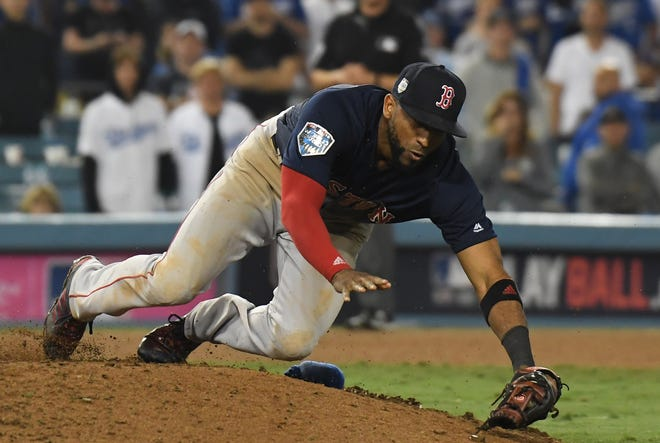 Eduardo Nunez falls over the mound while fielding a pop-up in the 16th inning.