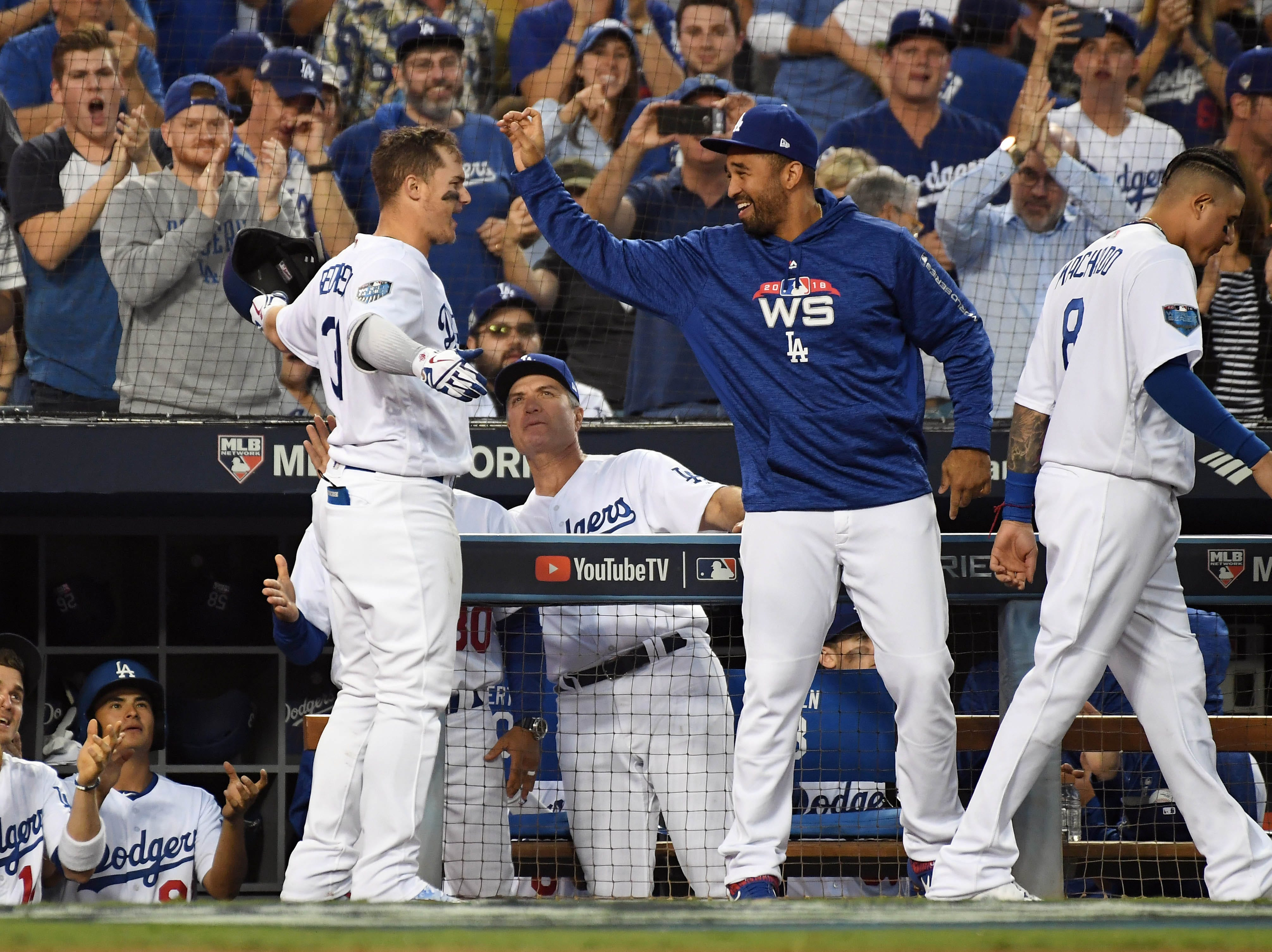 Game 3 at Dodger Stadium: Dodgers players celebrate Joc Pederon's home run in the third.