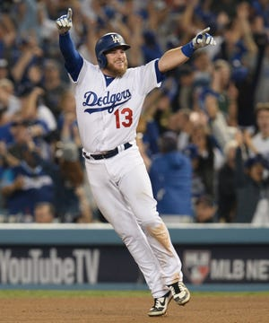 Max Muncy celebrates after hitting a walk-off homer in the 18th inning.