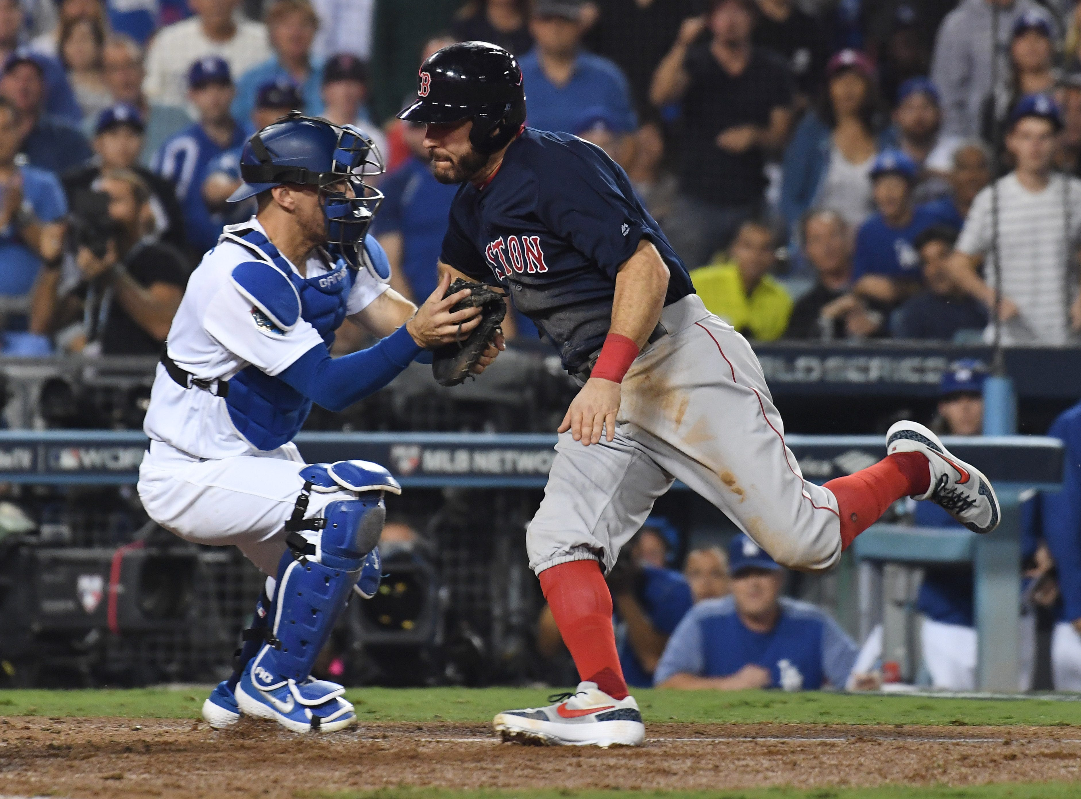 Game 3 at Dodger Stadium: Ian Kinsler is tagged out at home plate by Dodgers catcher Austin Barnes in the 10th.