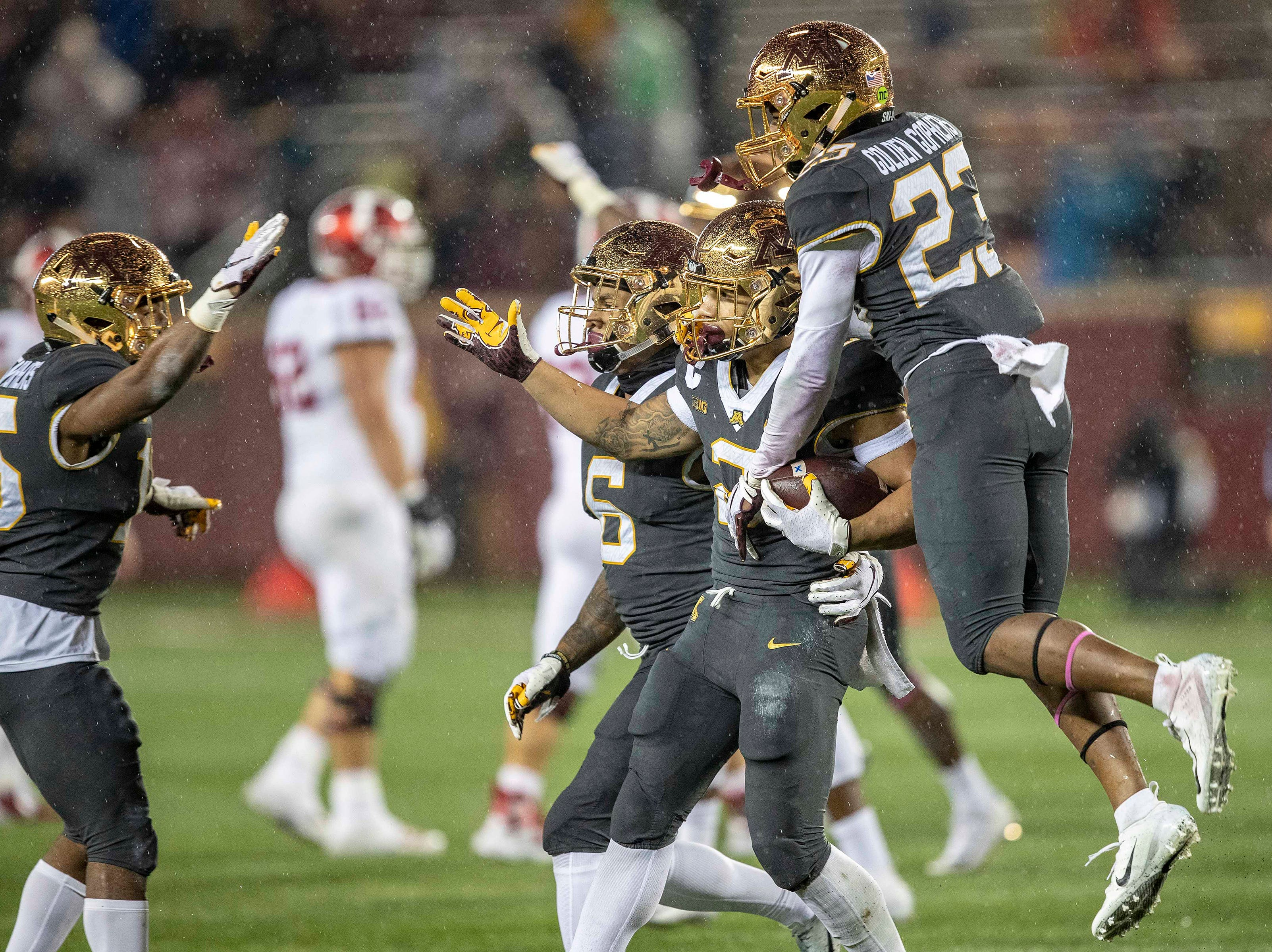 Minnesota Golden Gophers defensive back Jacob Huff (2) celebrates with defensive back Jordan Howden (23) after intercepting a pass in the second half against the Indiana Hoosiers at TCF Bank Stadium.