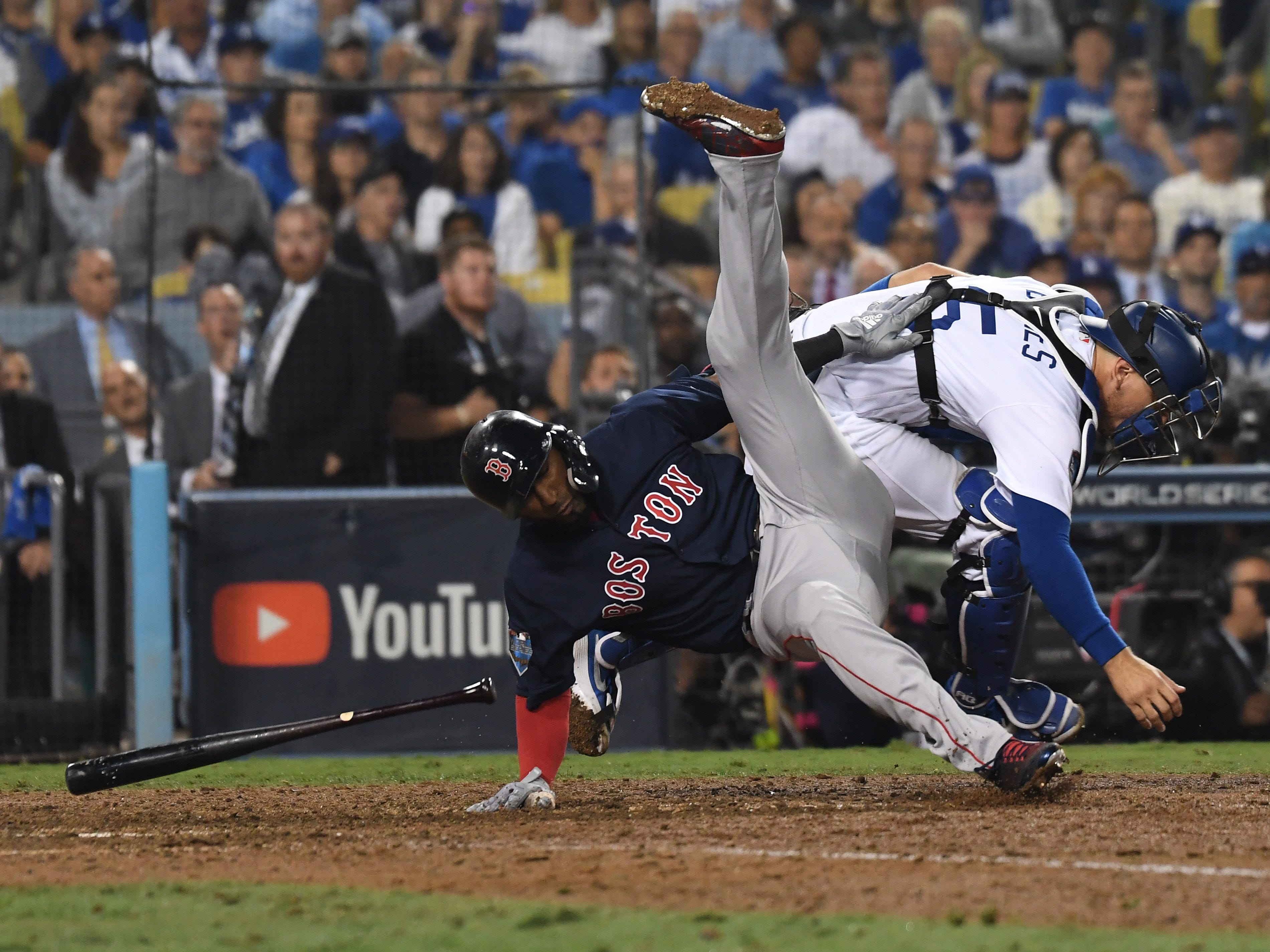 Game 3 at Dodger Stadium: Eduardo Nunez falls over as Austin Barnes goes after a ball in the dirt in the 13th inning.