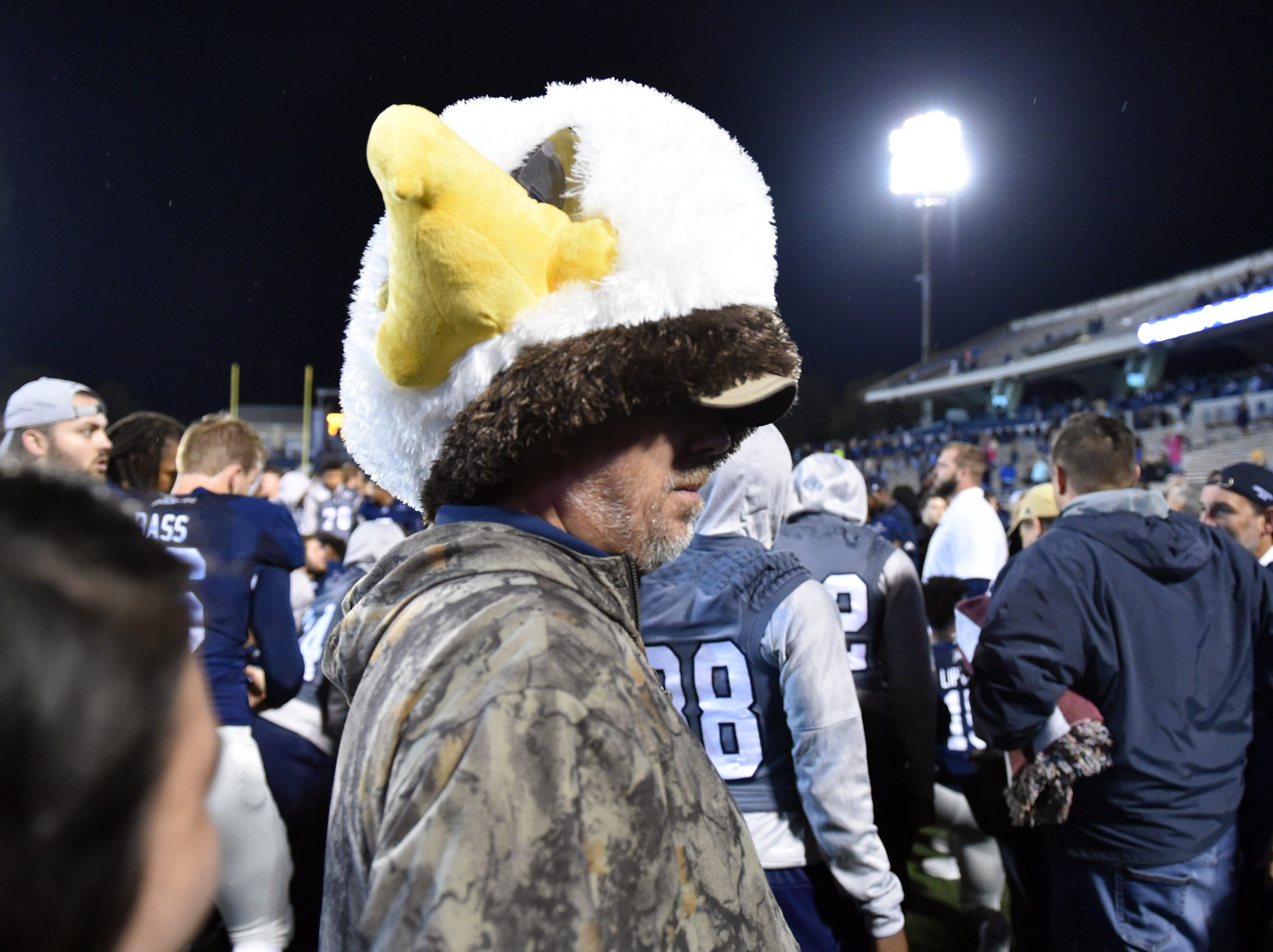 Week 9: A fan wears the Georgia Southern Eagles mascot head after finding it on the ground after defeating the team defeated the Appalachian State Mountaineers at Allen E. Paulson Stadium.