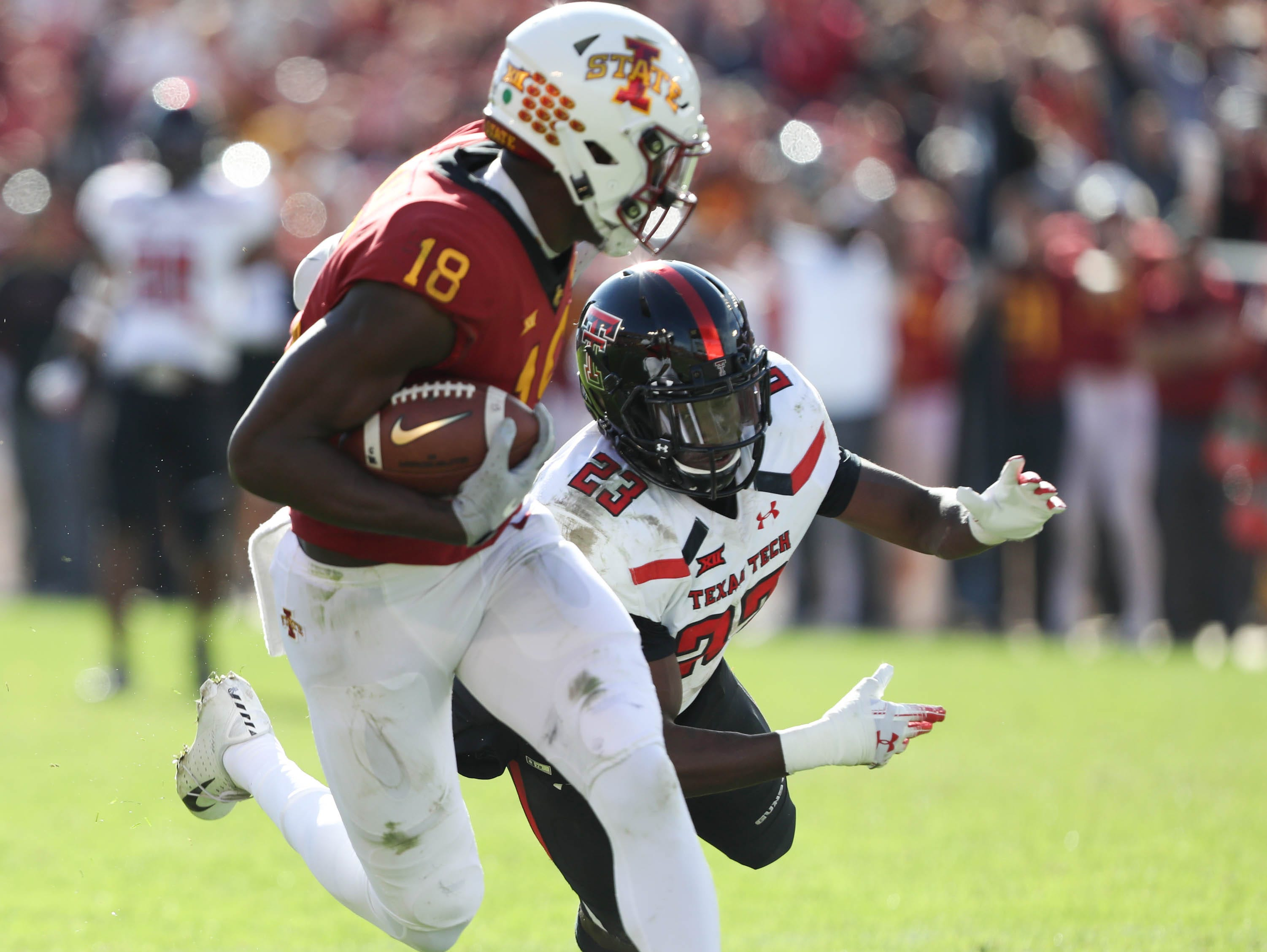 Iowa State Cyclones wide receiver Hakeem Butler (18) catches a pass for the touchdown late in the fourth quarter as Texas Tech Red Raiders defensive back Damarcus Fields (23) makes a late attempt for the tackle at Jack Trice Stadium.