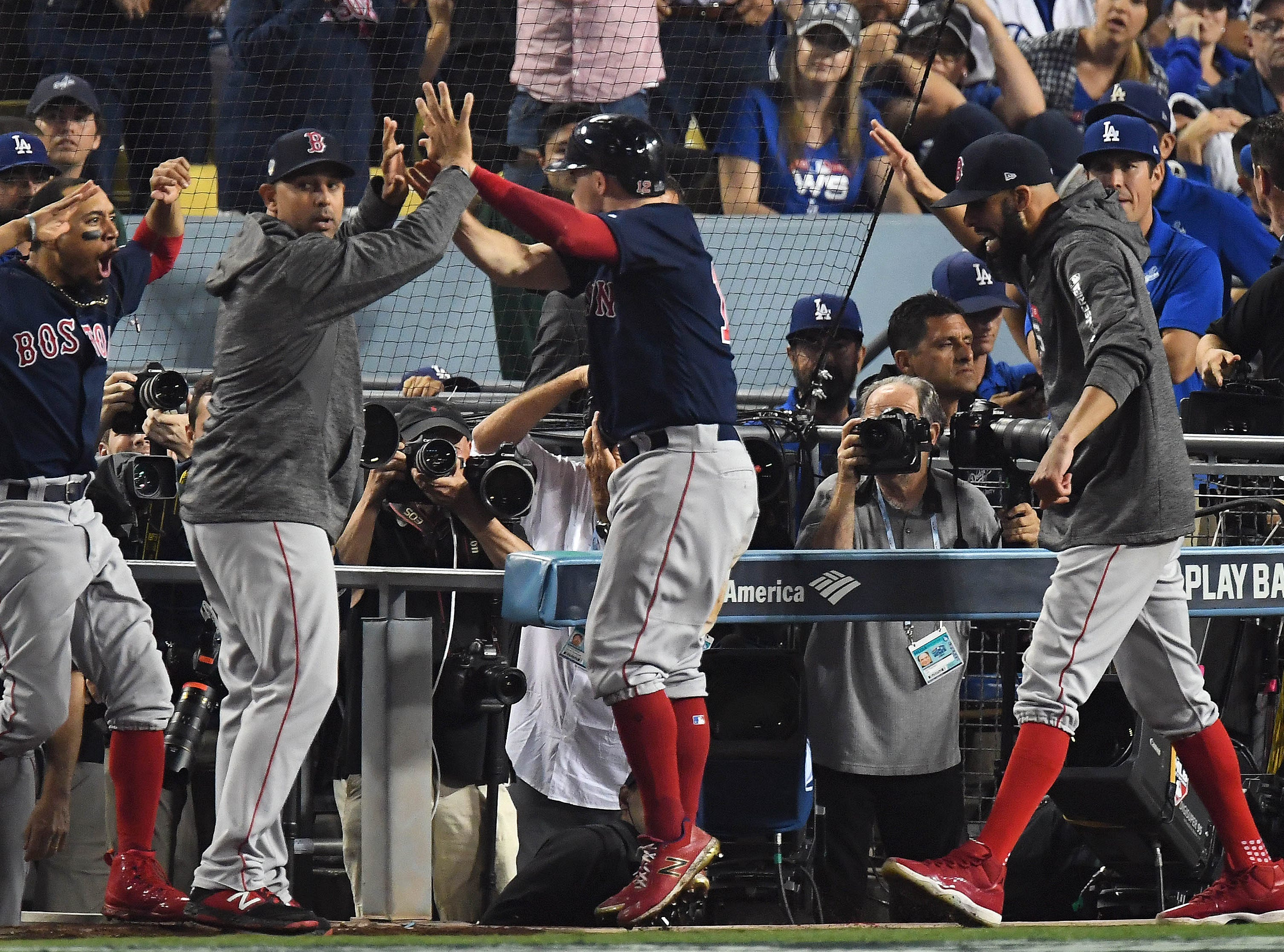 Game 3 at Dodger Stadium: The Red Sox celebrate after scoring the go-ahead run in the 13th inning.