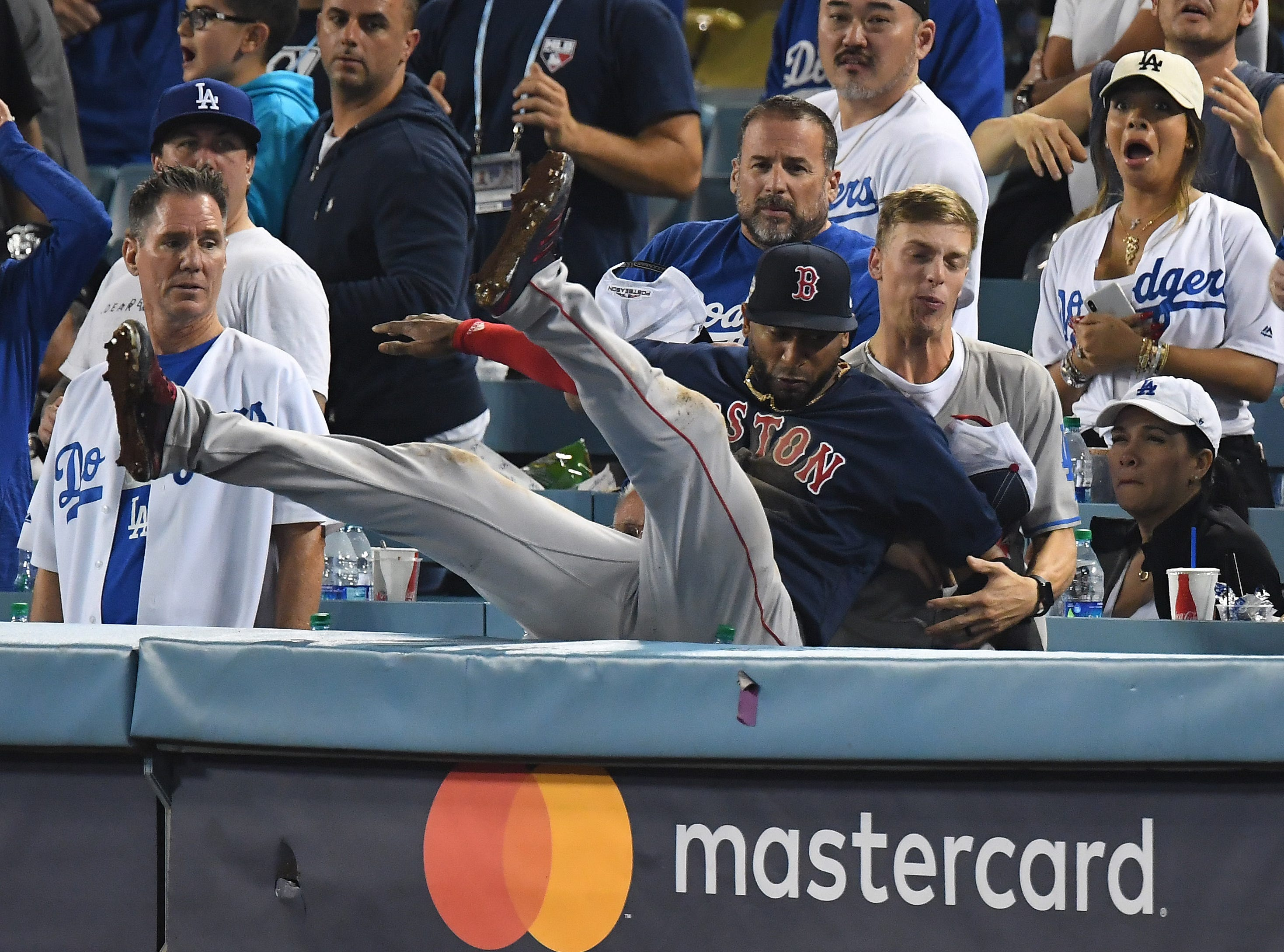 Game 3 at Dodger Stadium: Eduardo Nunez makes the catch and falls into the stands in the 13th inning.