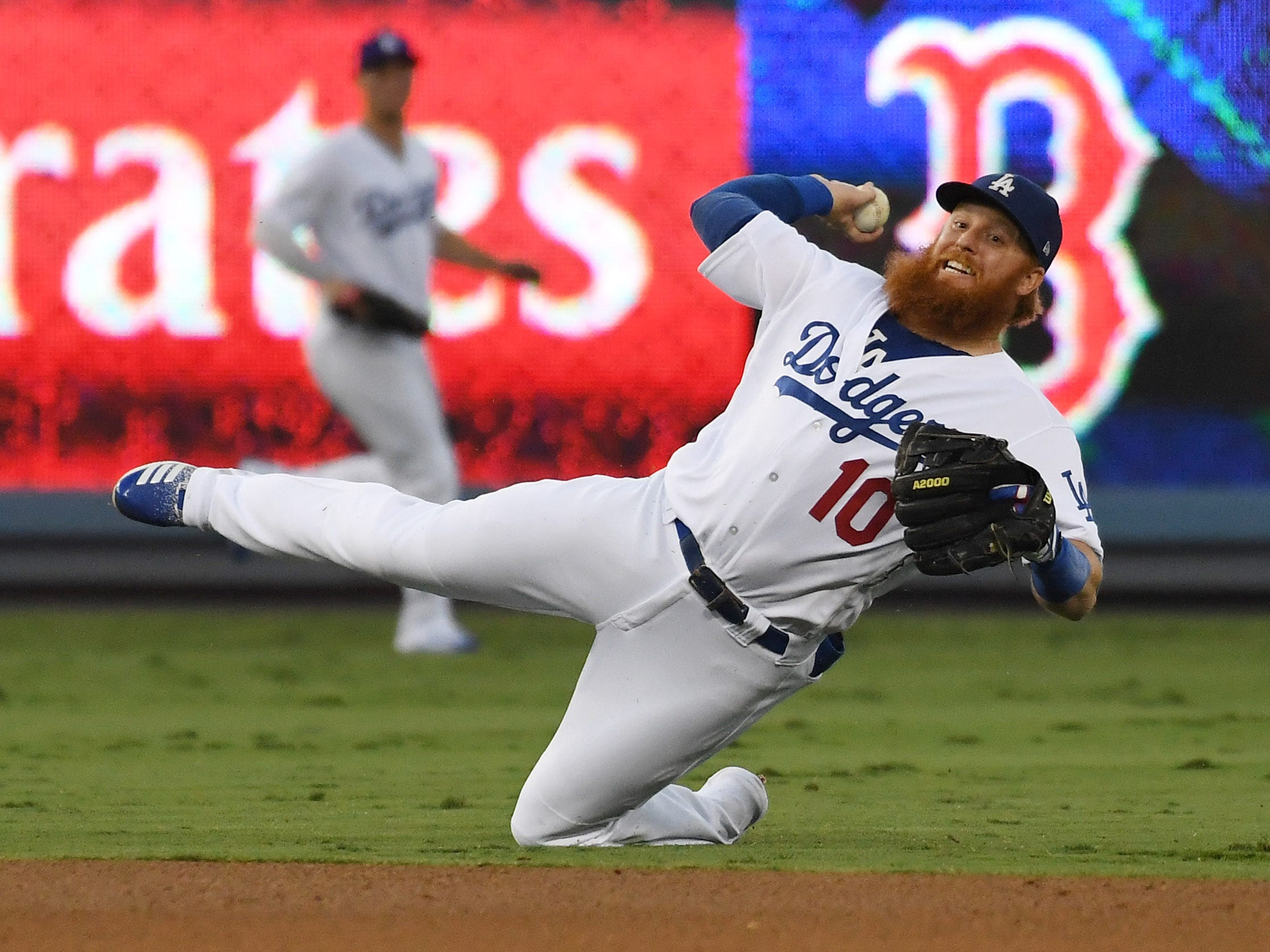 Game 3 at Dodgers Stadium: Justin Turner fields an infield single by Jackie Bradley Jr. in the third inning.