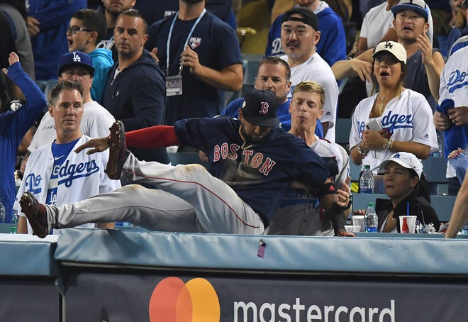 Eduardo Nunez fell into the stands making a catch in foul territory in the 13th.