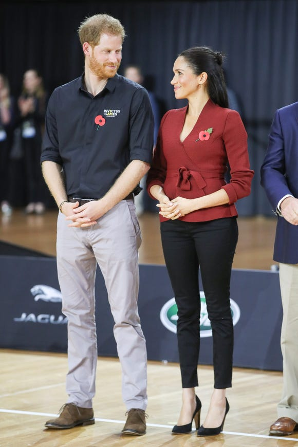 The duke and the duchess exchange glances in the metal game of Basketball Basketball Gold at Invictus Games Sydney 2018.