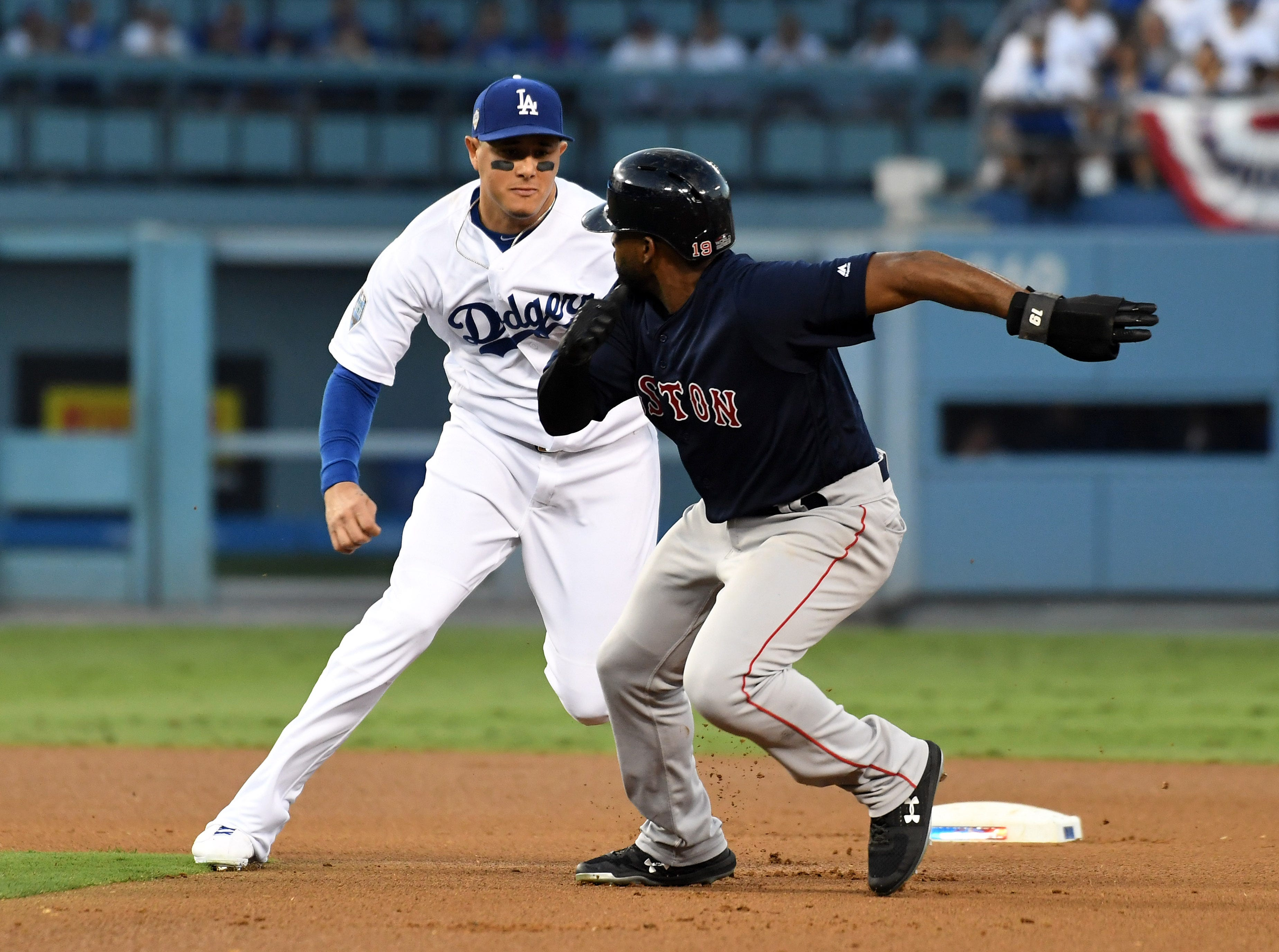 Game 3 at Dodgers Stadium: Manny Machado tags out Jackie Bradley Jr. trying to steal in the third inning.