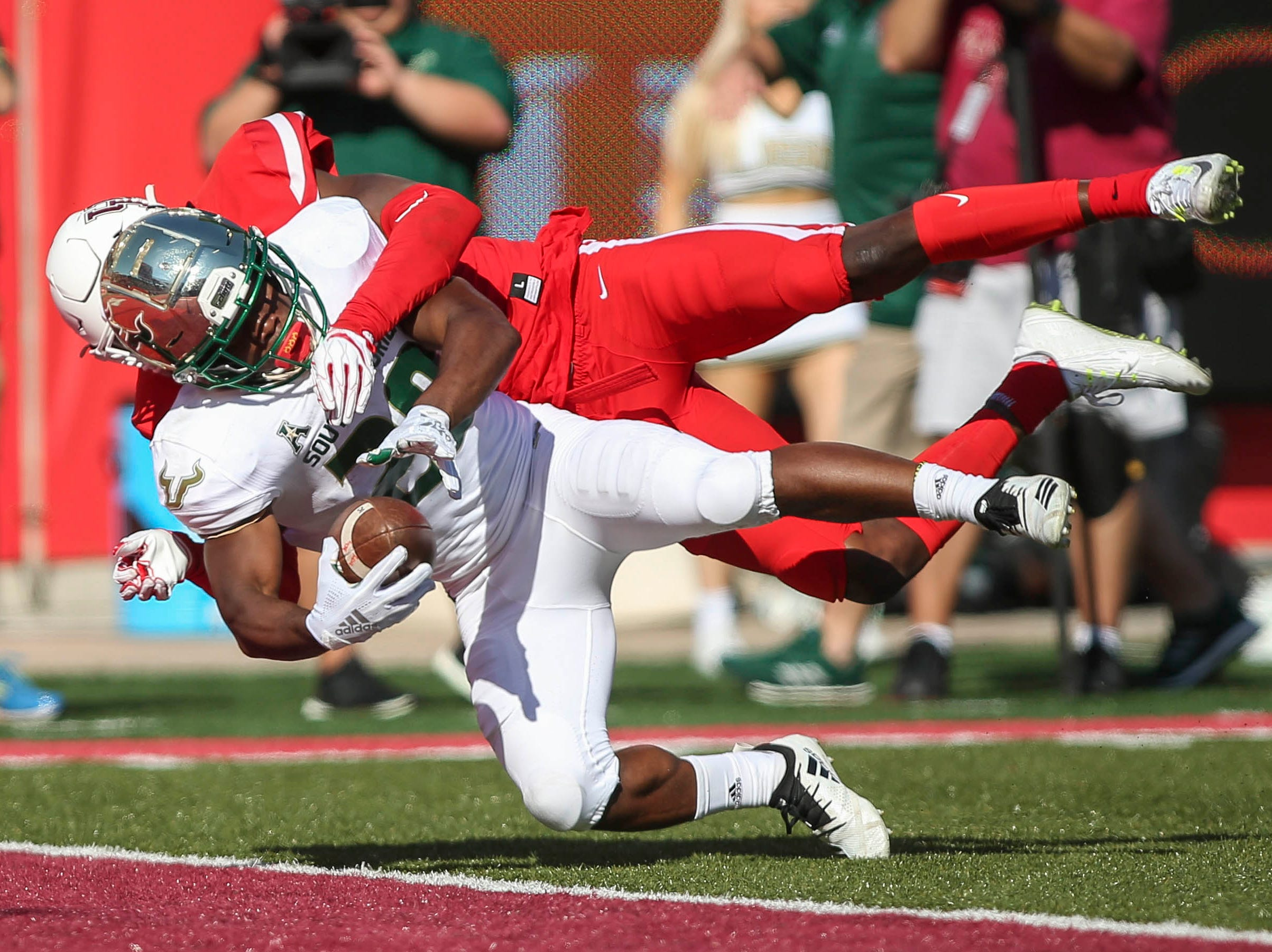 South Florida Bulls running back Johnny Ford (20) scores a touchdown as Houston Cougars cornerback Isaiah Johnson (14) defends during the second quarter at TDECU Stadium.