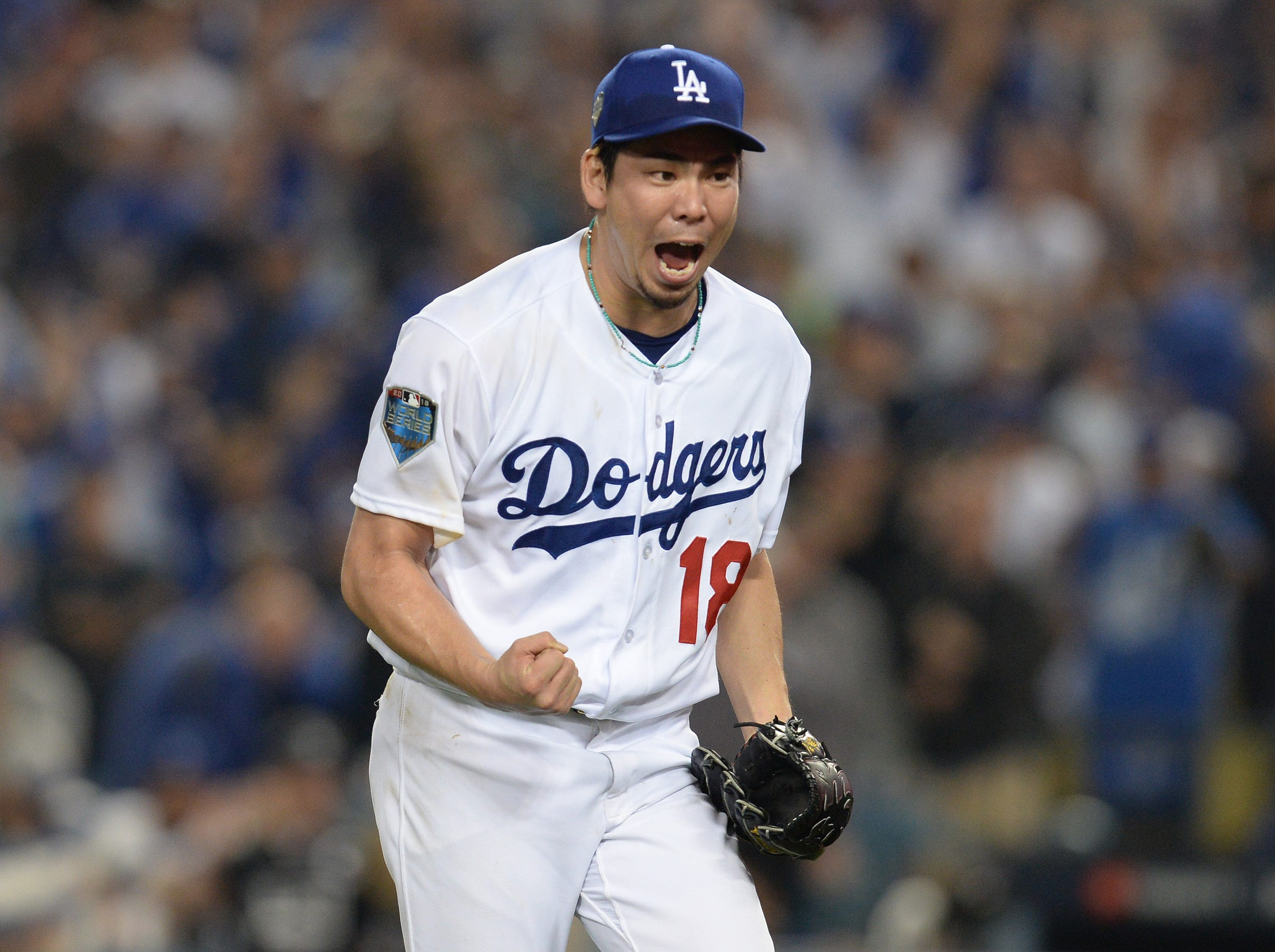Game 3 at Dodger Stadium: Kenta Maeda celebrates a strikeout to end the top of the 15th.