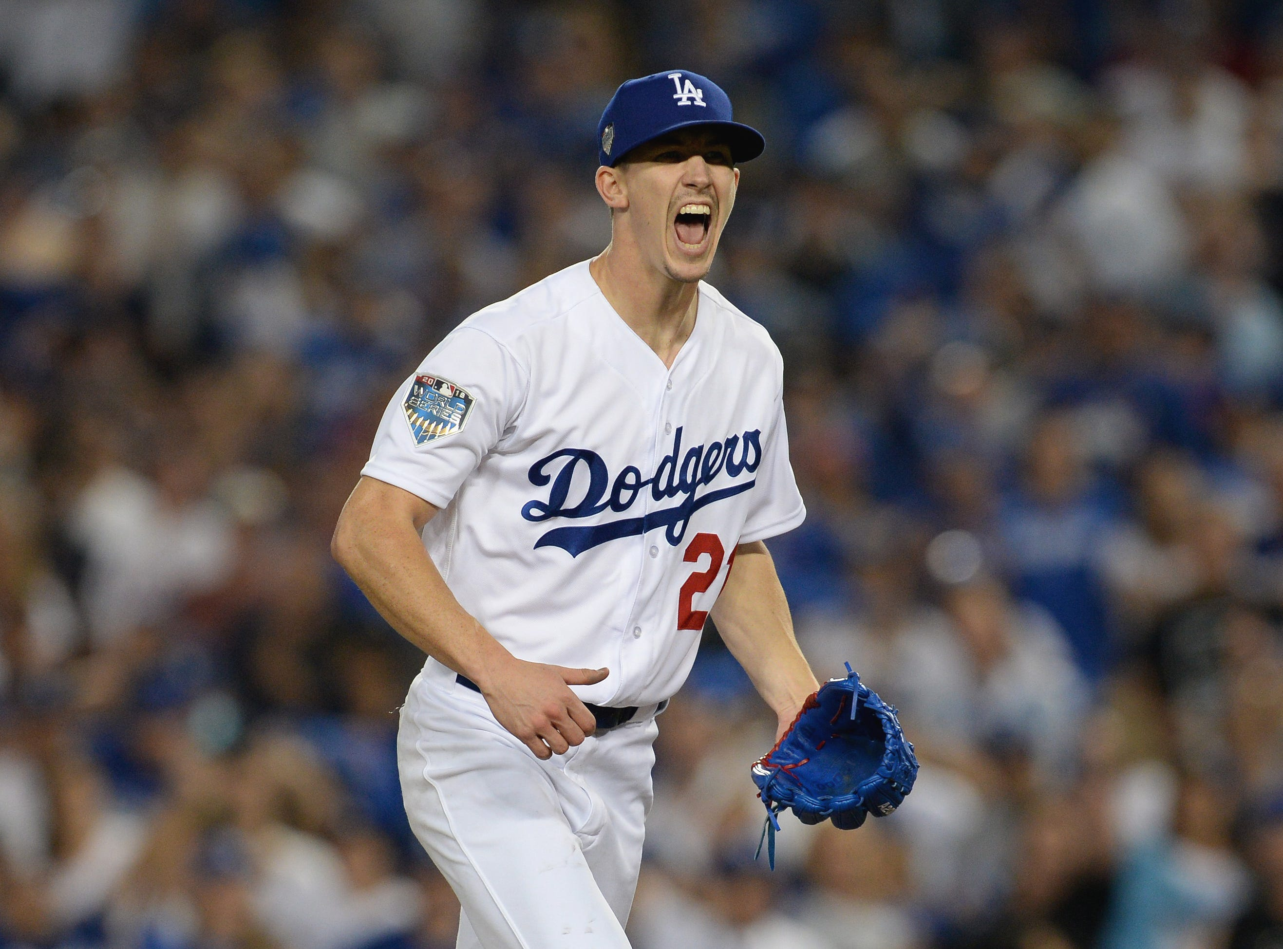 Game 3 at Dodger Stadium: Walker Buehler reacts in the fourth inning.