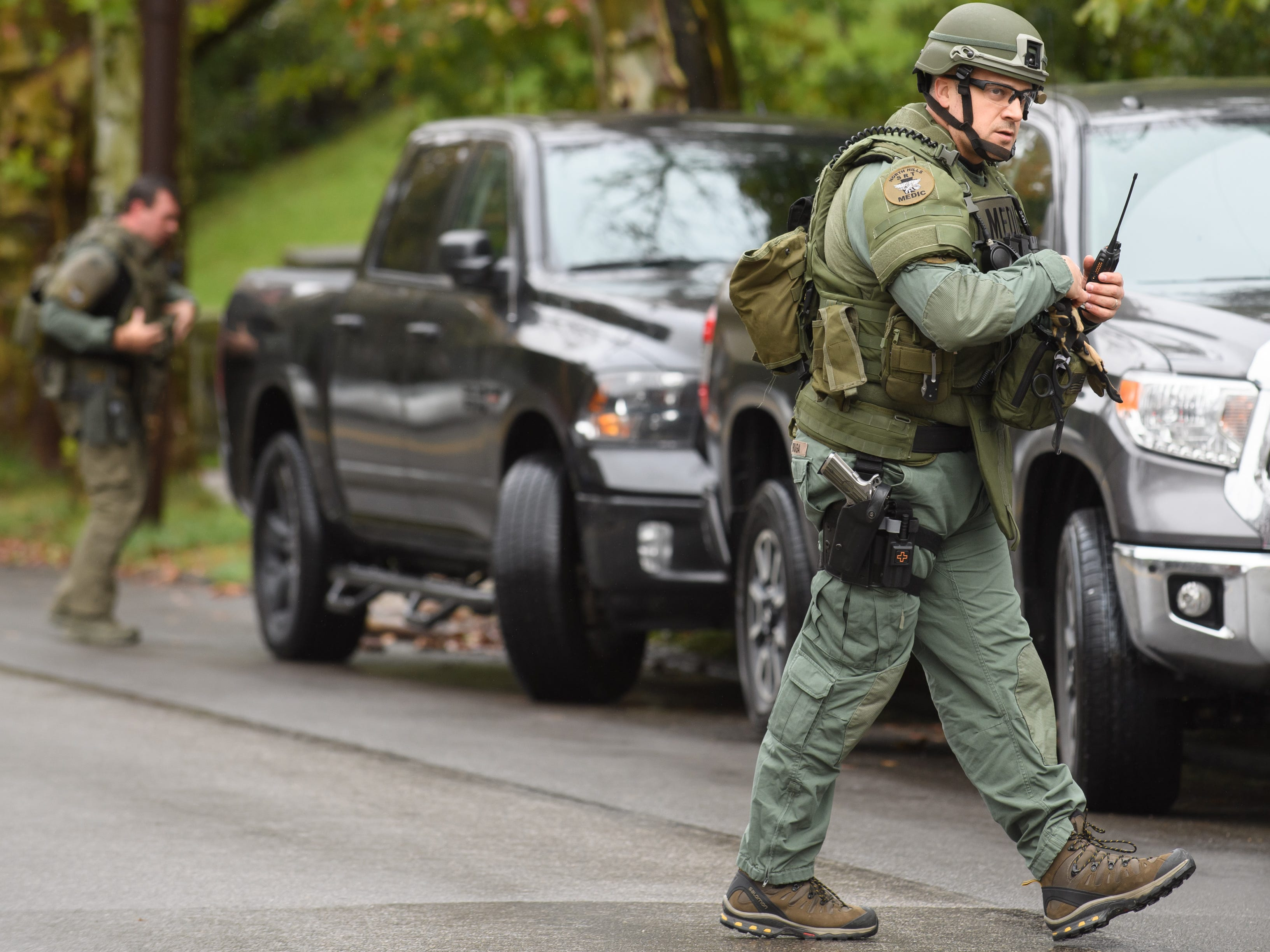 Police rapid response team members respond to the site of a mass shooting at the Tree of Life Congregation.