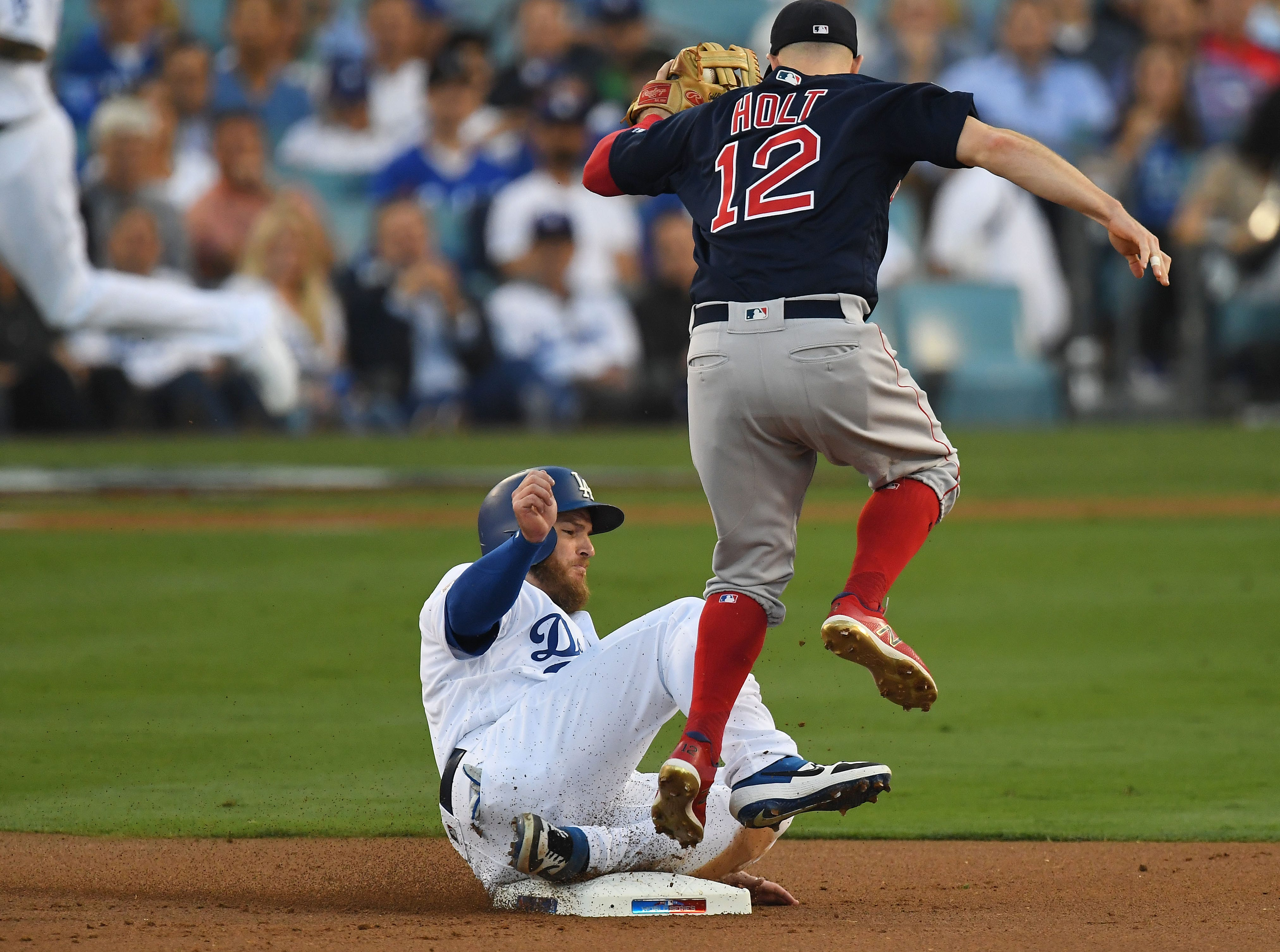 Game 3 at Dodger Stadium: Max Muncy is out at second as Bock Holt makes the play.