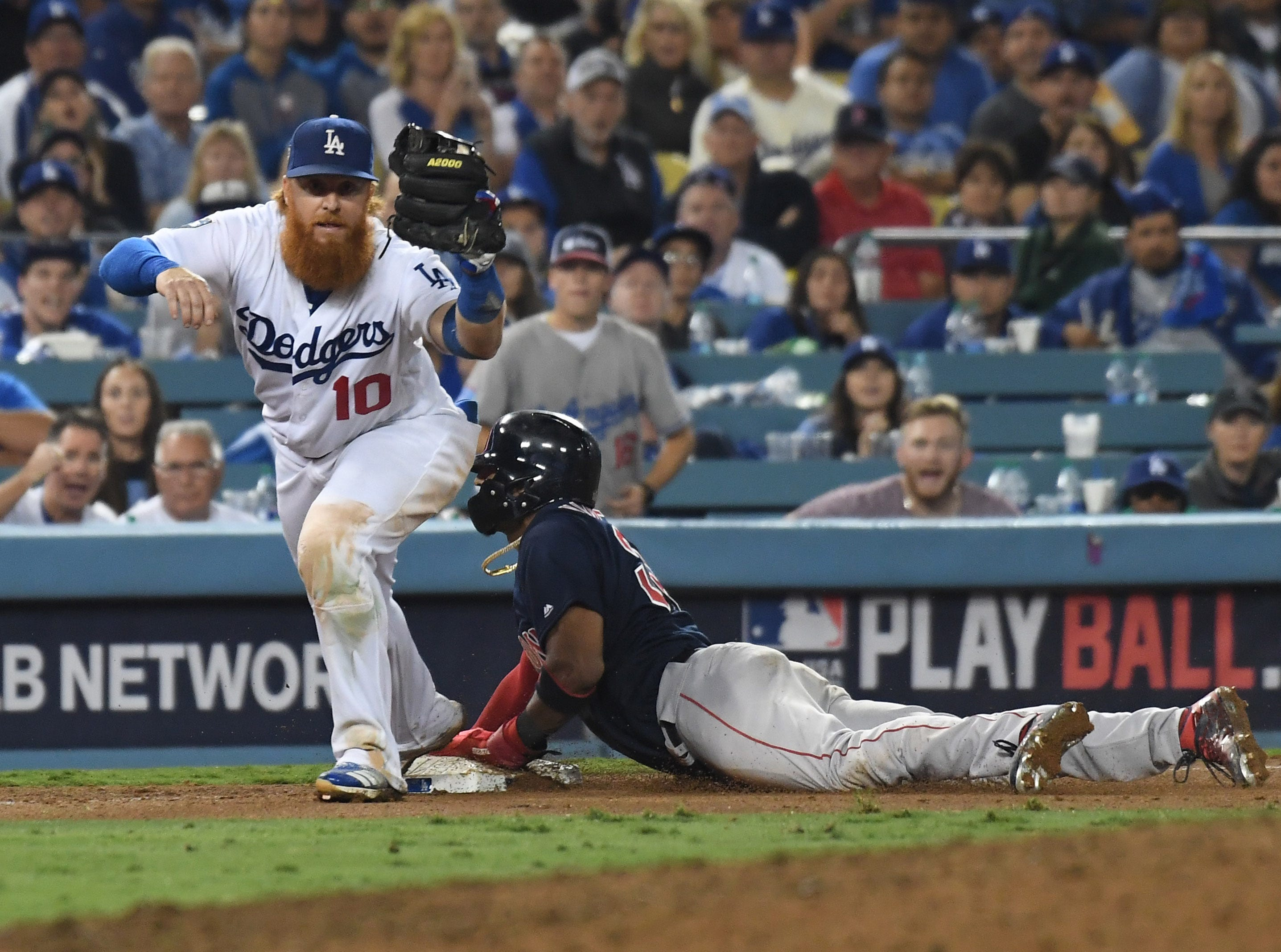 Game 3 at Dodger Stadium: Eduardo Nunez is forced out at a third in the top of the 15th.