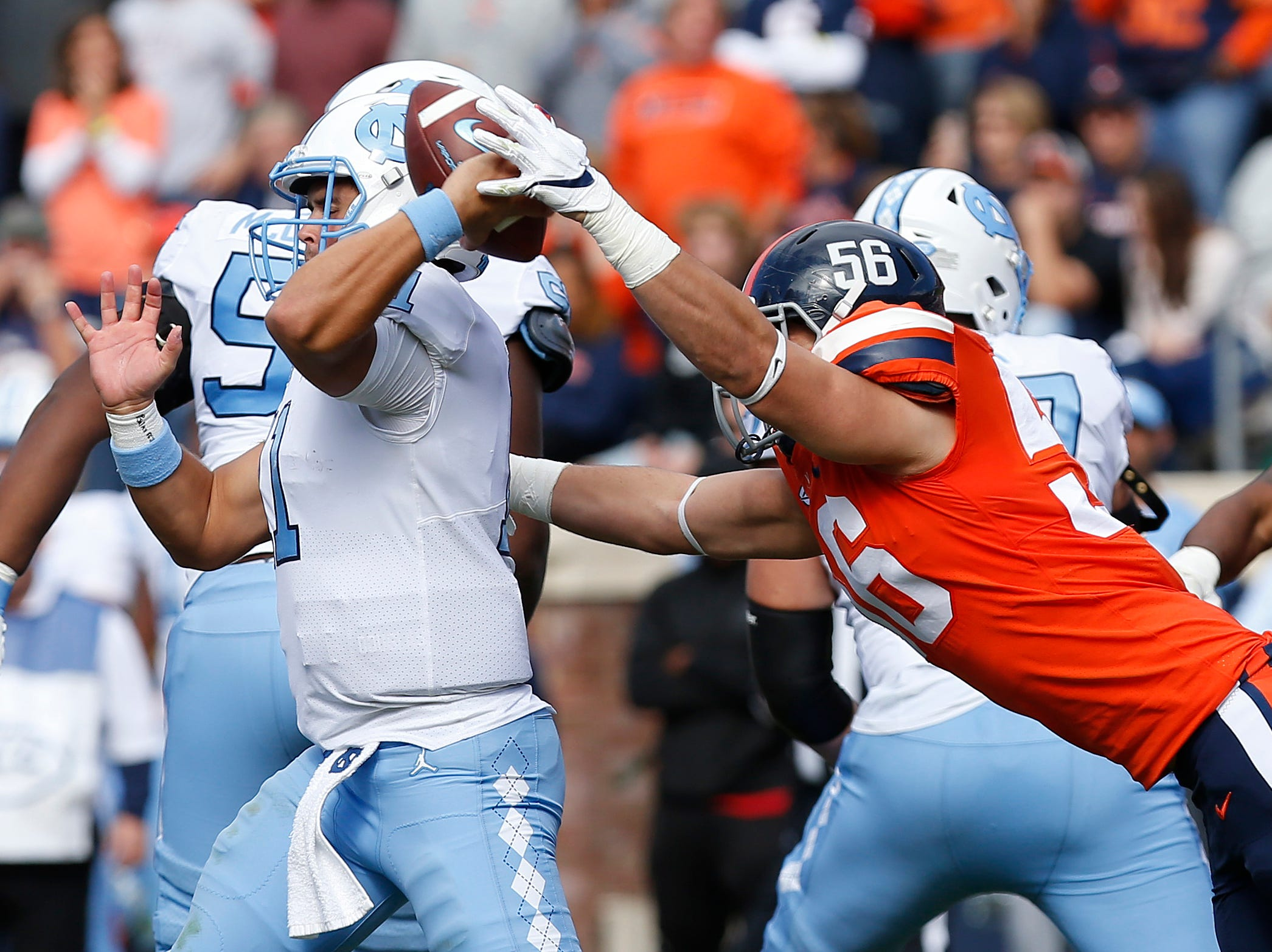 Virginia Cavaliers linebacker Matt Gahm (56) attempts to sack North Carolina Tar Heels quarterback Nathan Elliott (11) in the fourth quarter at Scott Stadium.