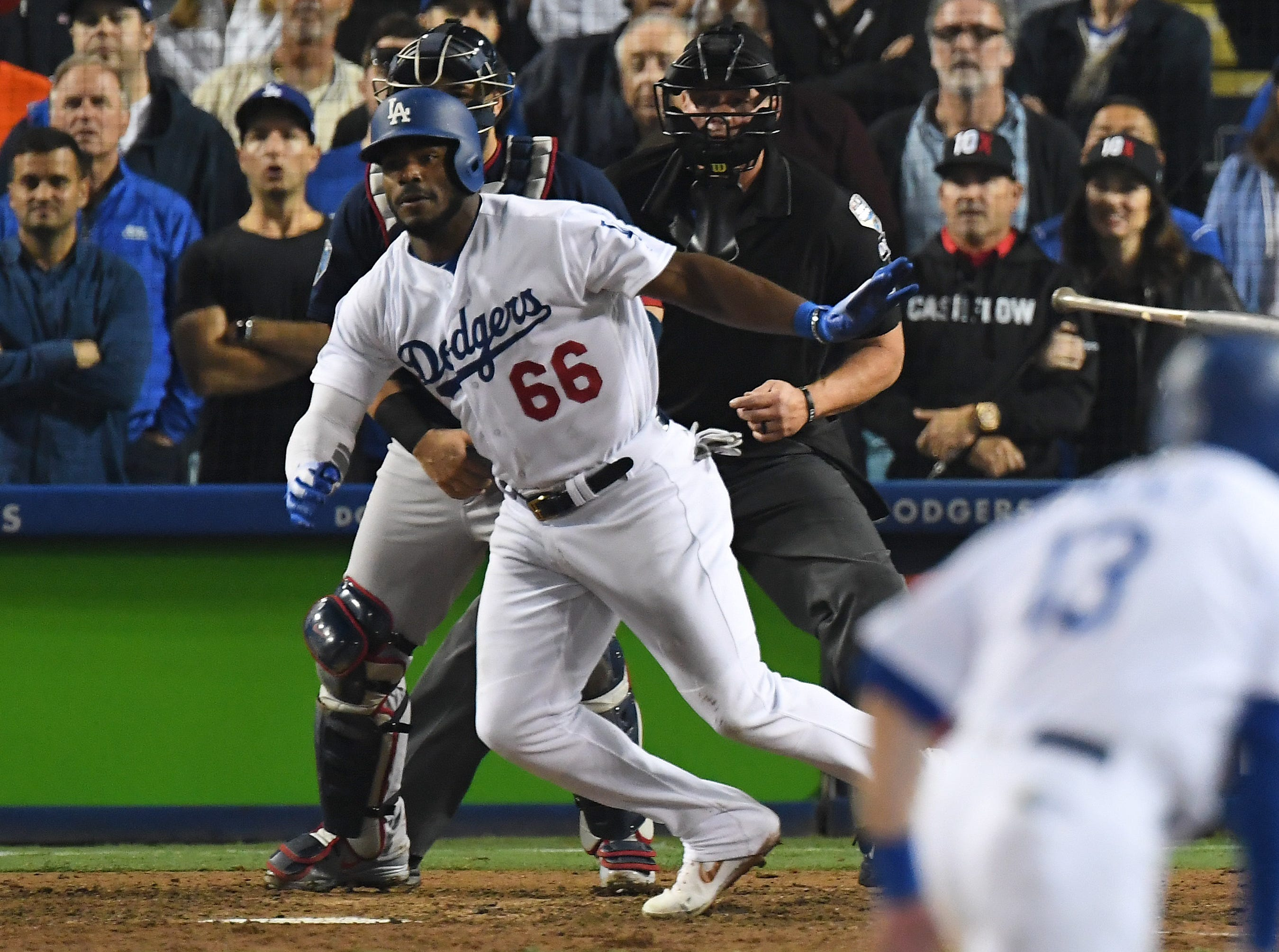 Game 3 at Dodger Stadium: Yasiel Puig hits an infield single that scored the tying run in the 13th inning.