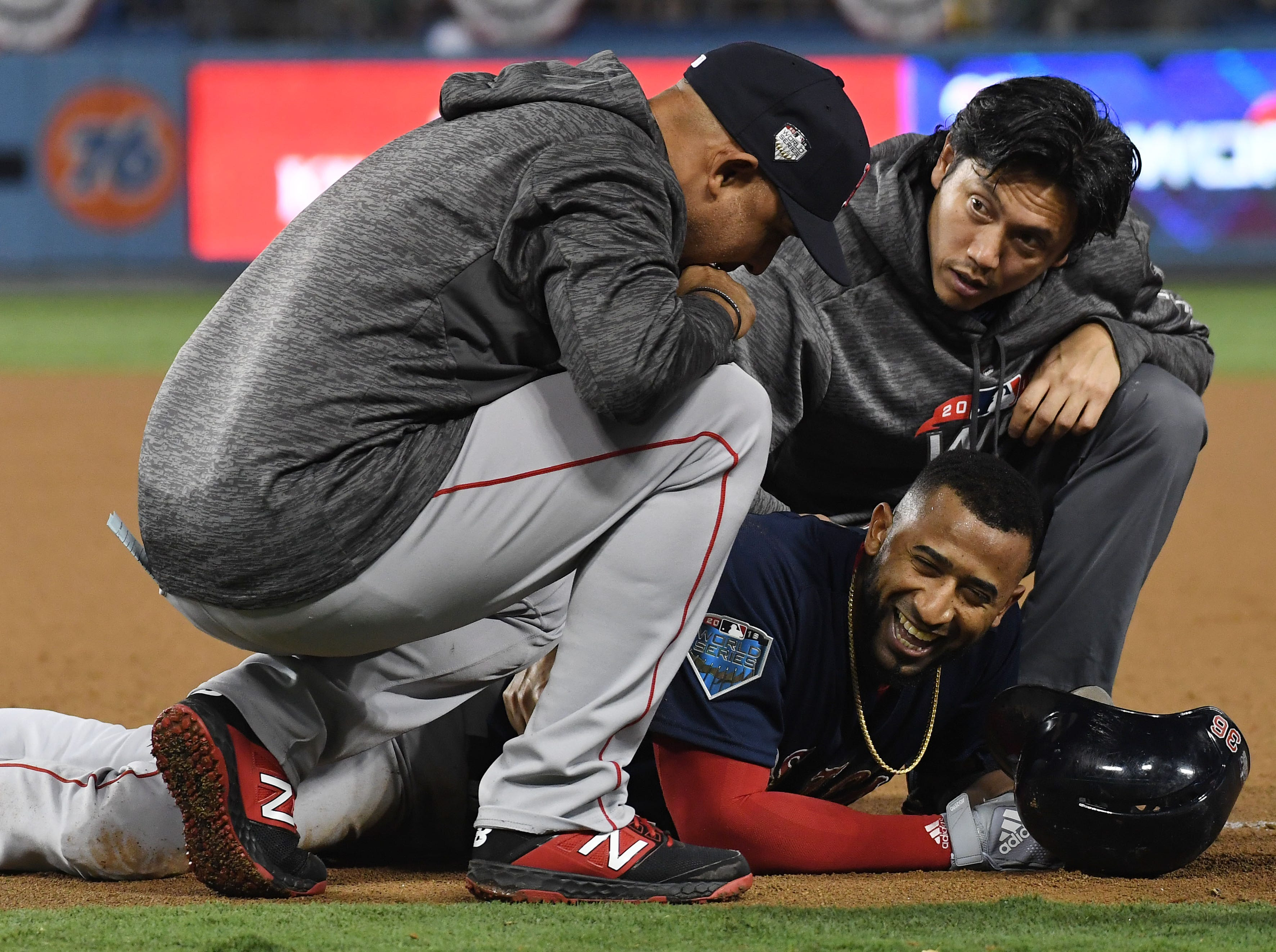 Game 3 at Dodger Stadium: Eduardo Nunez is checked on after sliding safely into first in the 13th inning. The go-ahead run scored on the play.
