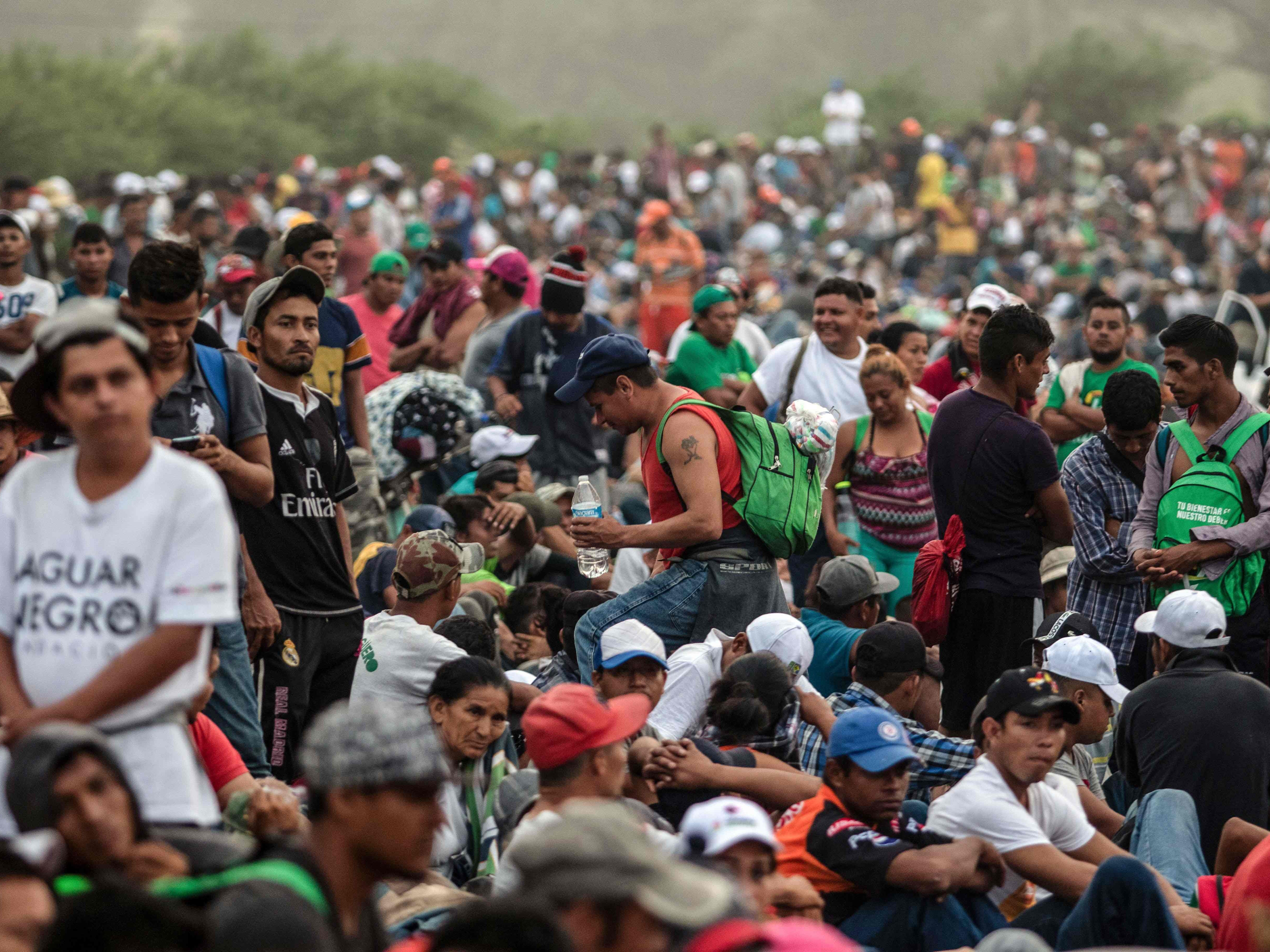 Honduran migrants taking part in a caravan heading to the U.S. wait on the road as they leave Arriaga on their way to San Pedro Tapanatepec, southern Mexico on Oct. 27, 2018.