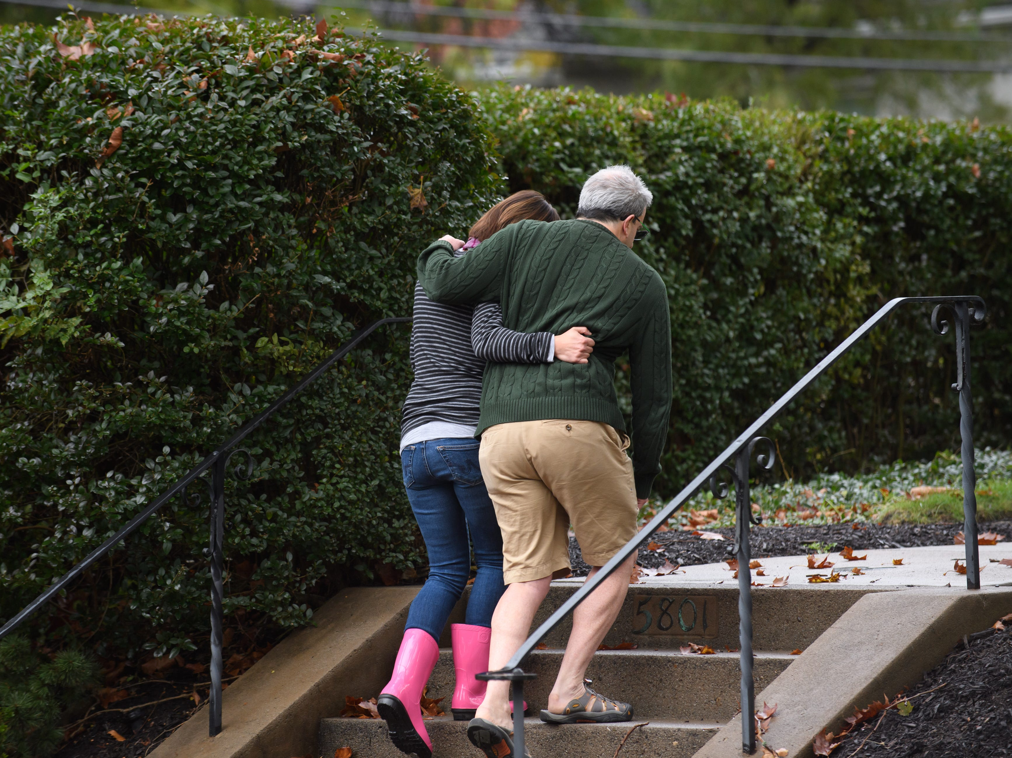 Neighbors around the corner from the site of a mass shooting at the Tree of Life Synagogue embrace one another in the Squirrel Hill neighborhood in Pittsburgh, Pa. on Oct. 27, 2018.