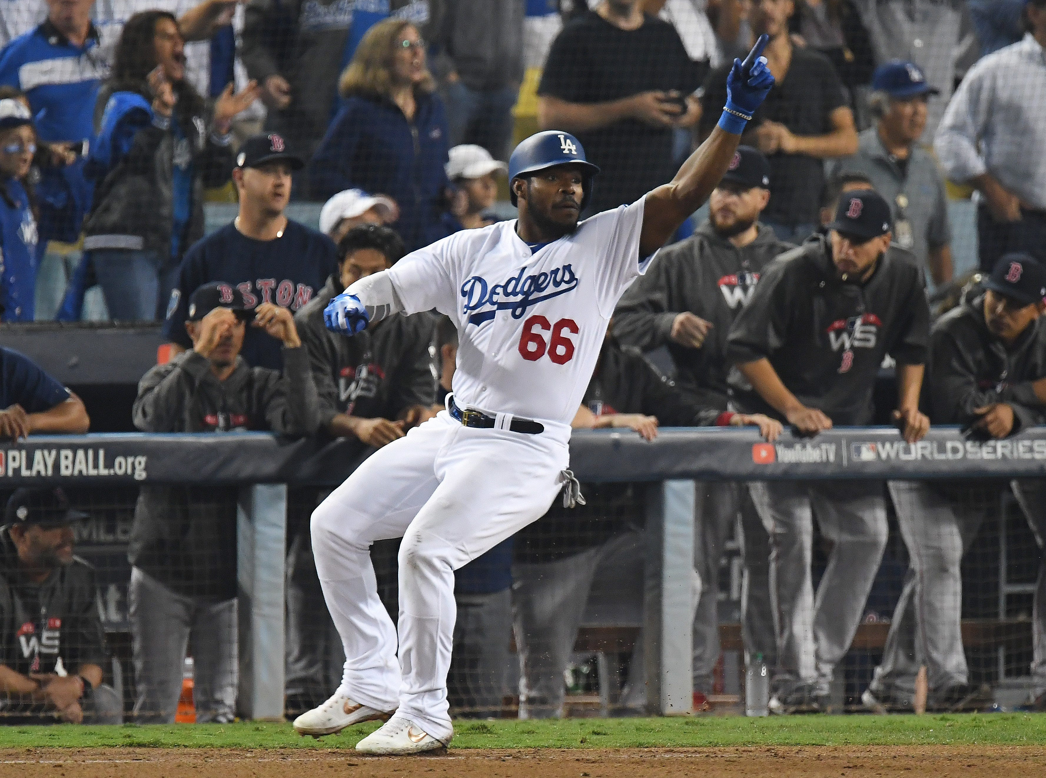 Game 3 at Dodger Stadium: Yasiel Puig reacts after the game-tying run scored in the bottom of the 13th.