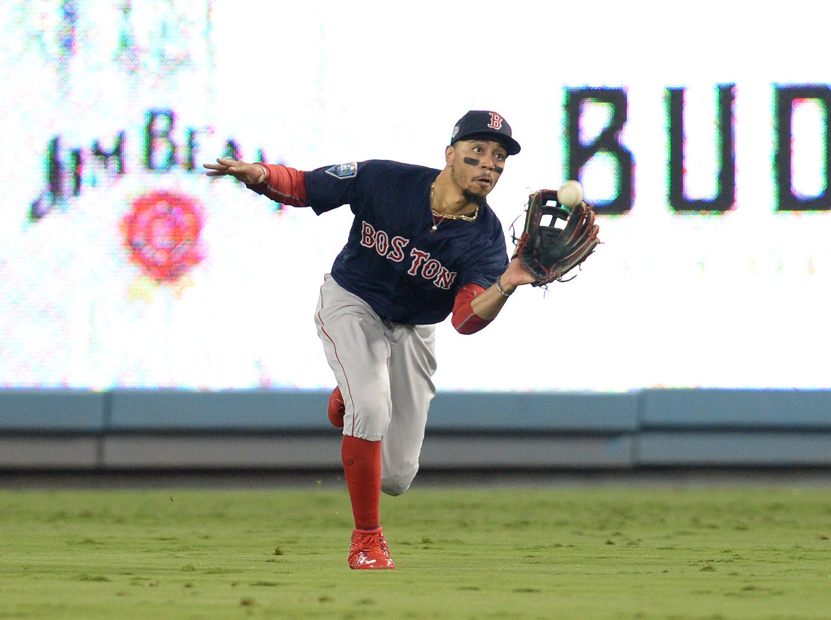 Game 3 at Dodger Stadium: Mookie Betts makes a catch in the sixth inning.